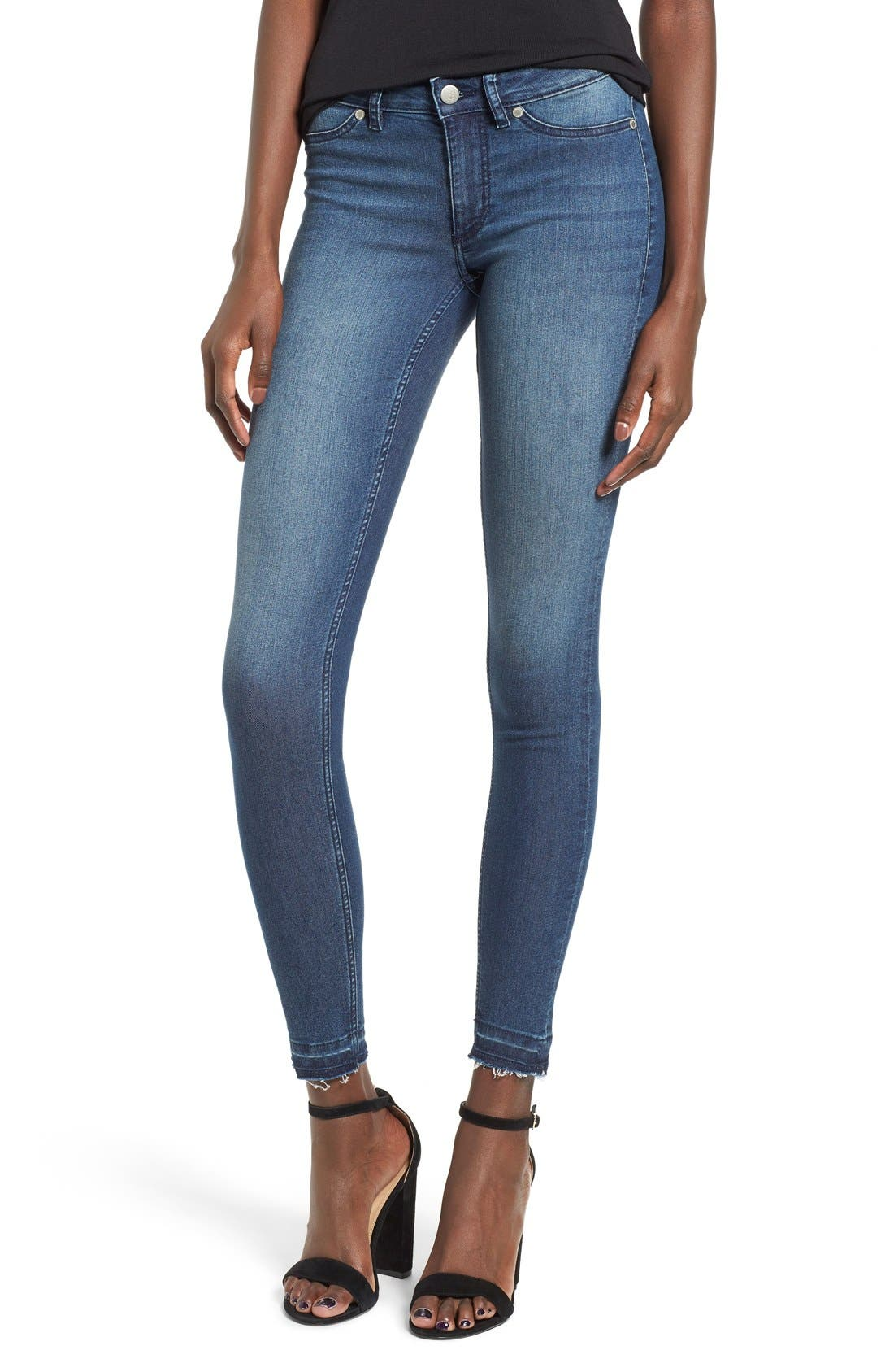 Main Image - Cheap Monday Released Hem Skinny Jeans (Fall Blue)