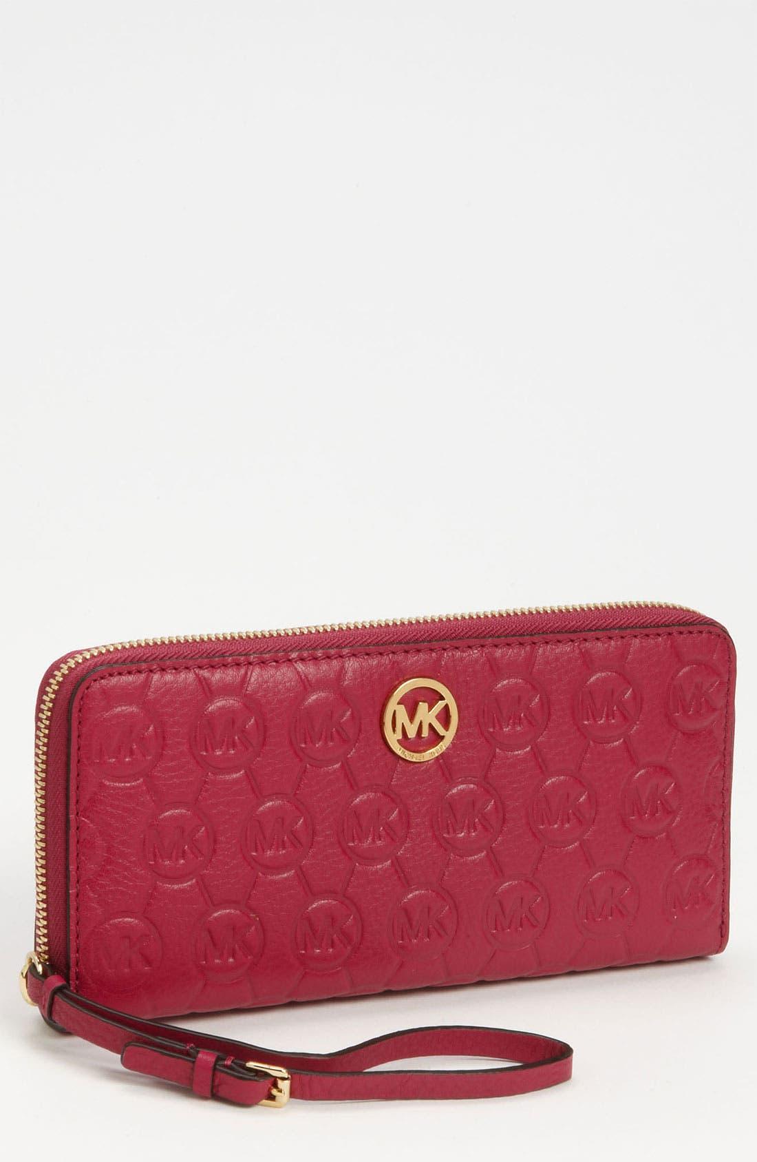 Main Image - MICHAEL Michael Kors Monogram Embossed Leather Wallet