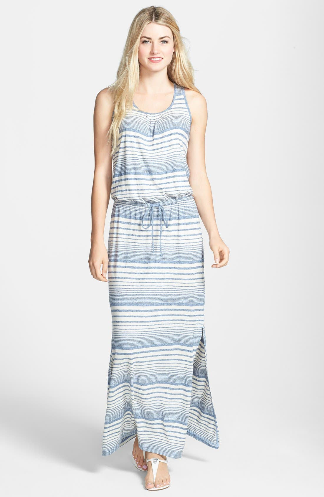 Up for sale is a new knit maxi dress from C&C California. It features a wide neckline, elbow-length sleeves, elastic waistband with drawstring, and long slits at the side hems. The fabric is 41% polyester, 36% cotton, and 23% rayon - machine wash/tumble dry.