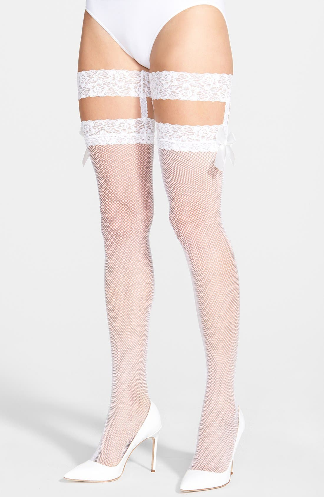 Alternate Image 1 Selected - Betsey Johnson Fishnet Thigh High Stockings with Lace Garters