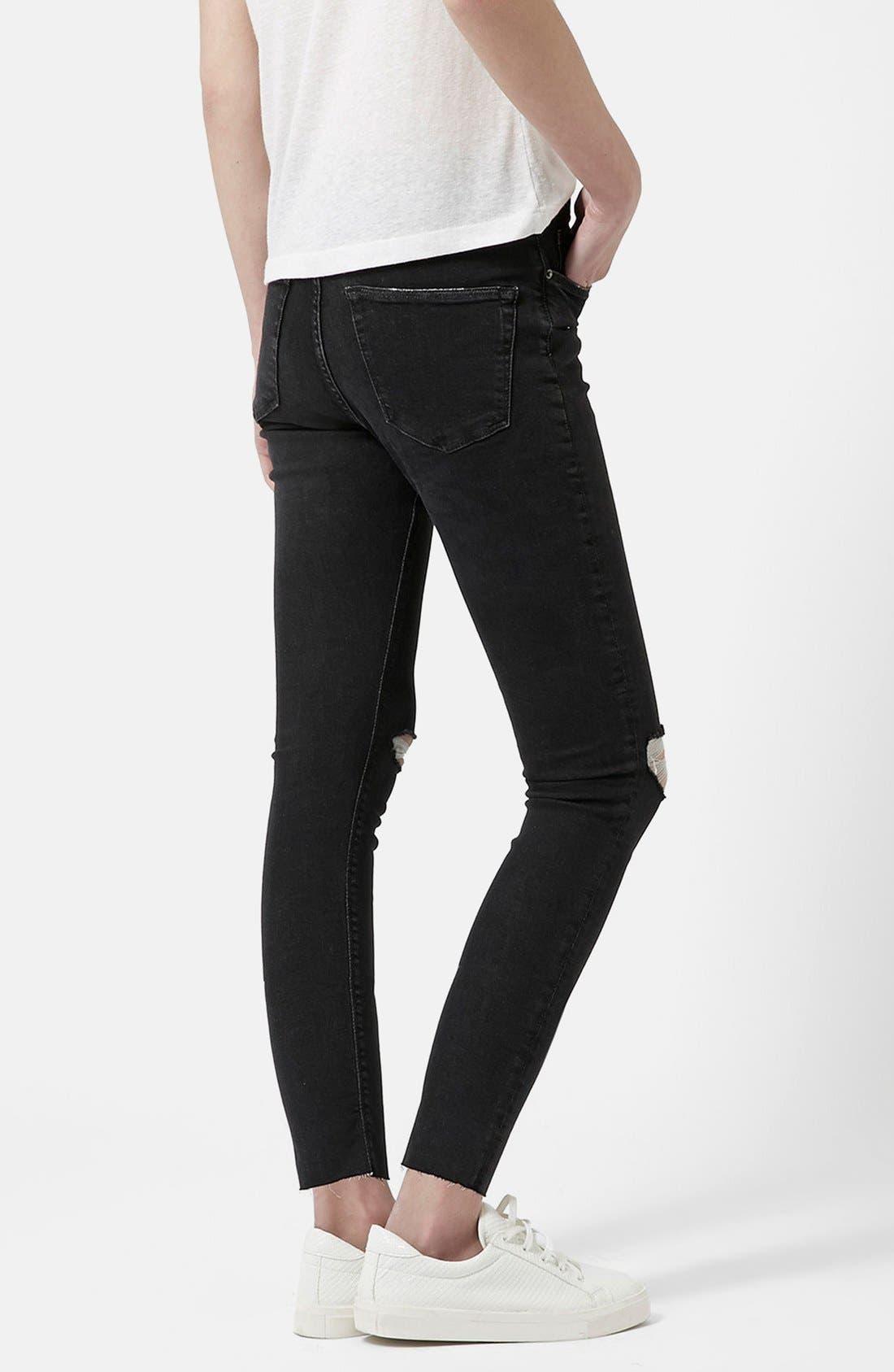 Alternate Image 2  - Topshop 'Jamie' Ripped Skinny Jeans (Black) (Petite)