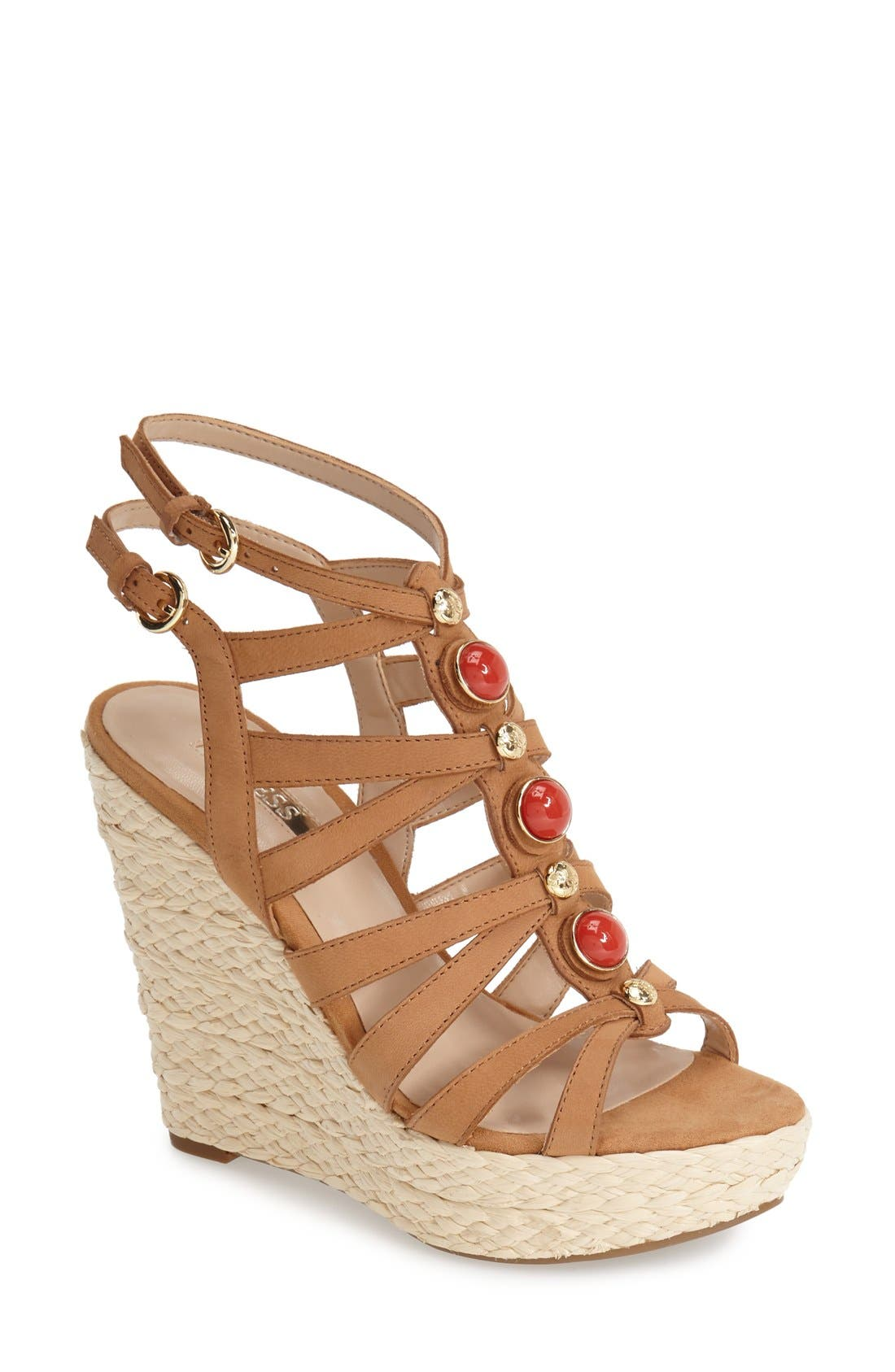 Alternate Image 1 Selected - GUESS 'Onixx' Snake Embossed Leather Wedge Sandal (Women)