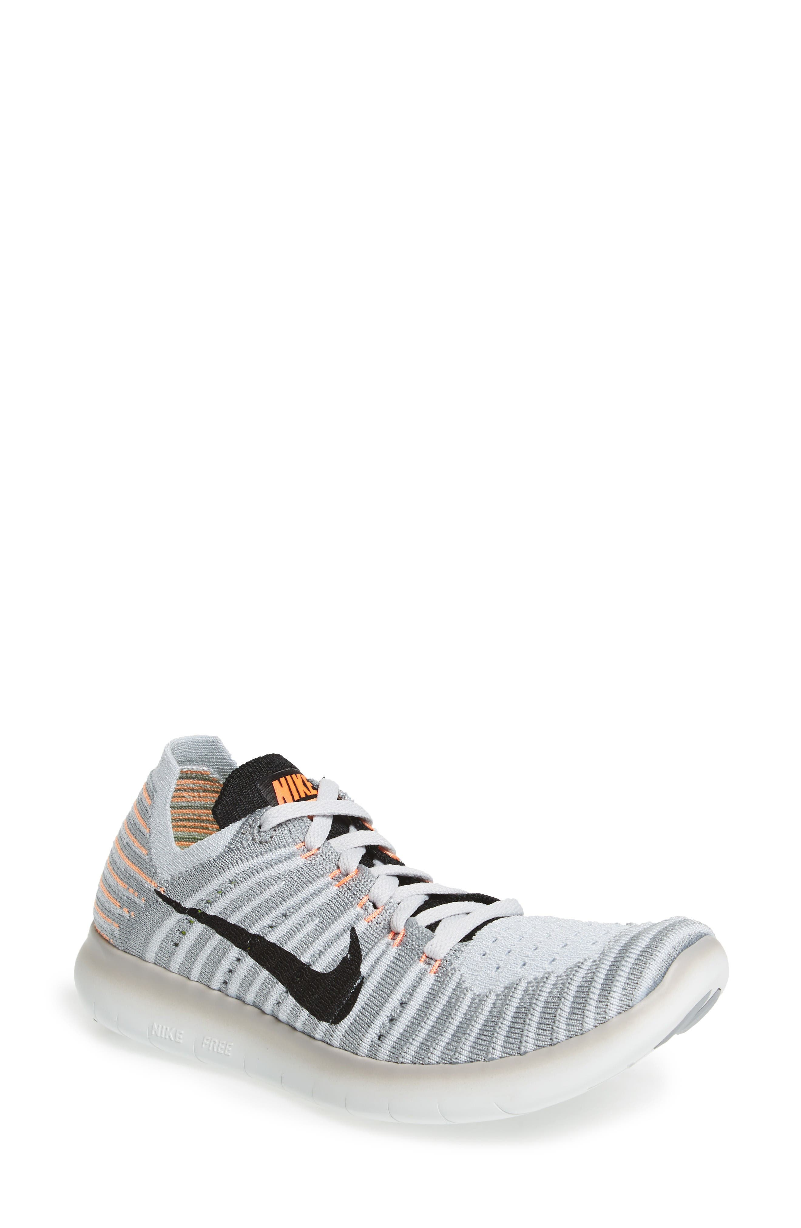 Alternate Image 1 Selected - Nike 'Free Flyknit' Running Shoe (Women)