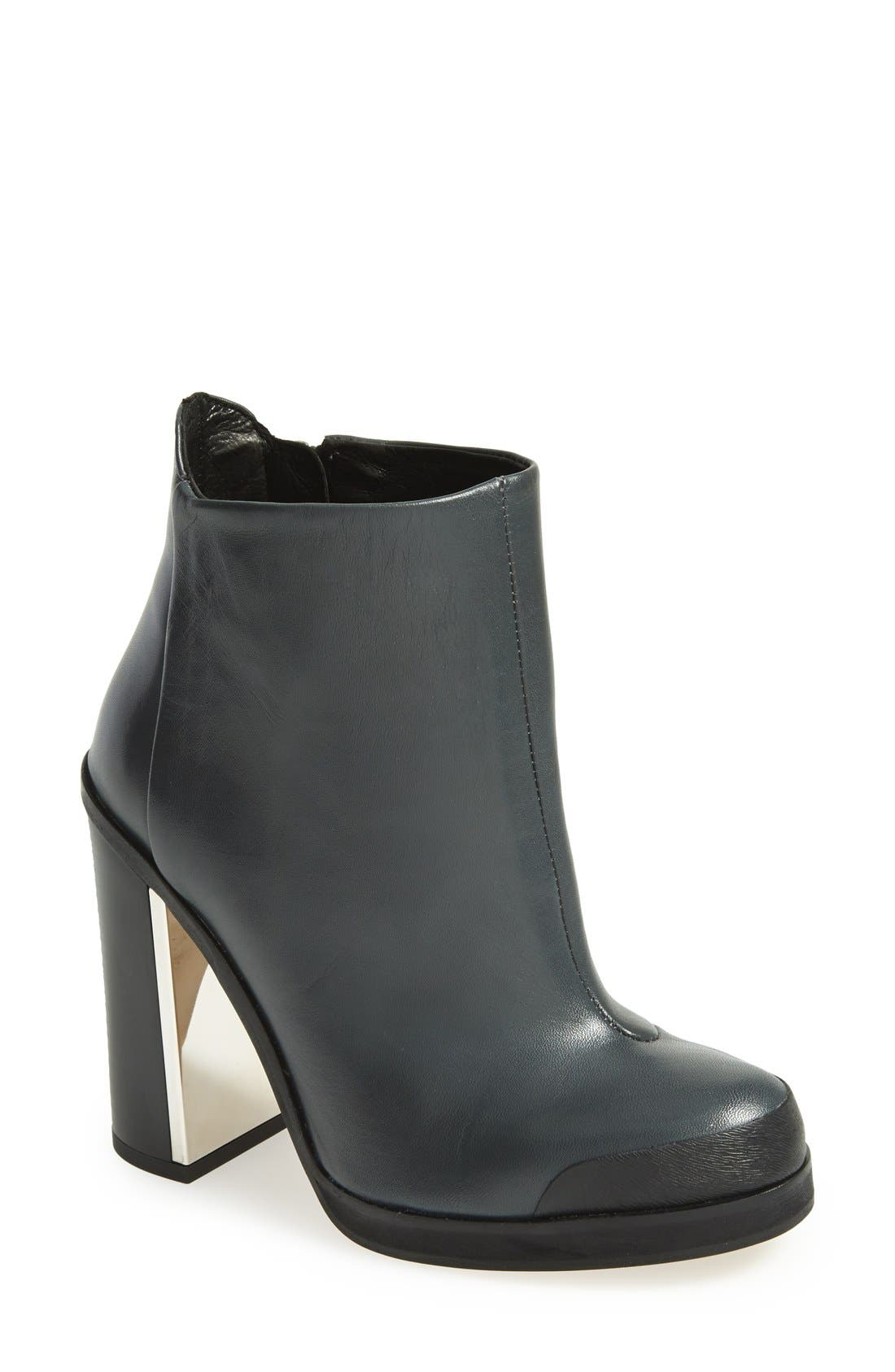 Alternate Image 1 Selected - Topshop 'Haunt' Metal Plate Ankle Bootie (Women)