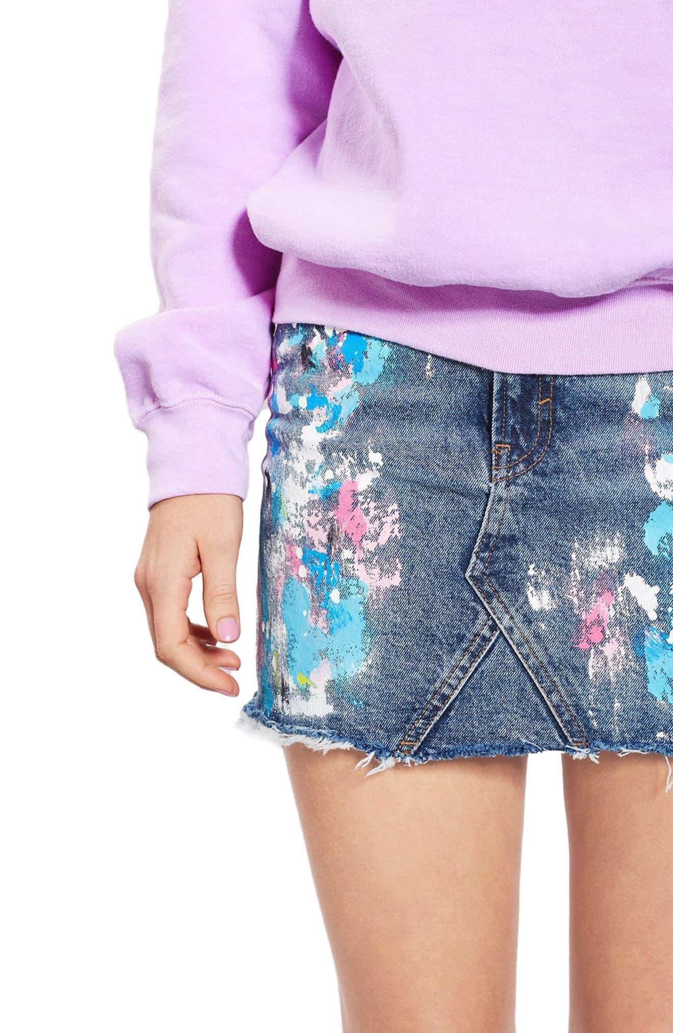 Alternate Image 1 Selected - Topshop Moto Splatter Paint Denim Miniskirt