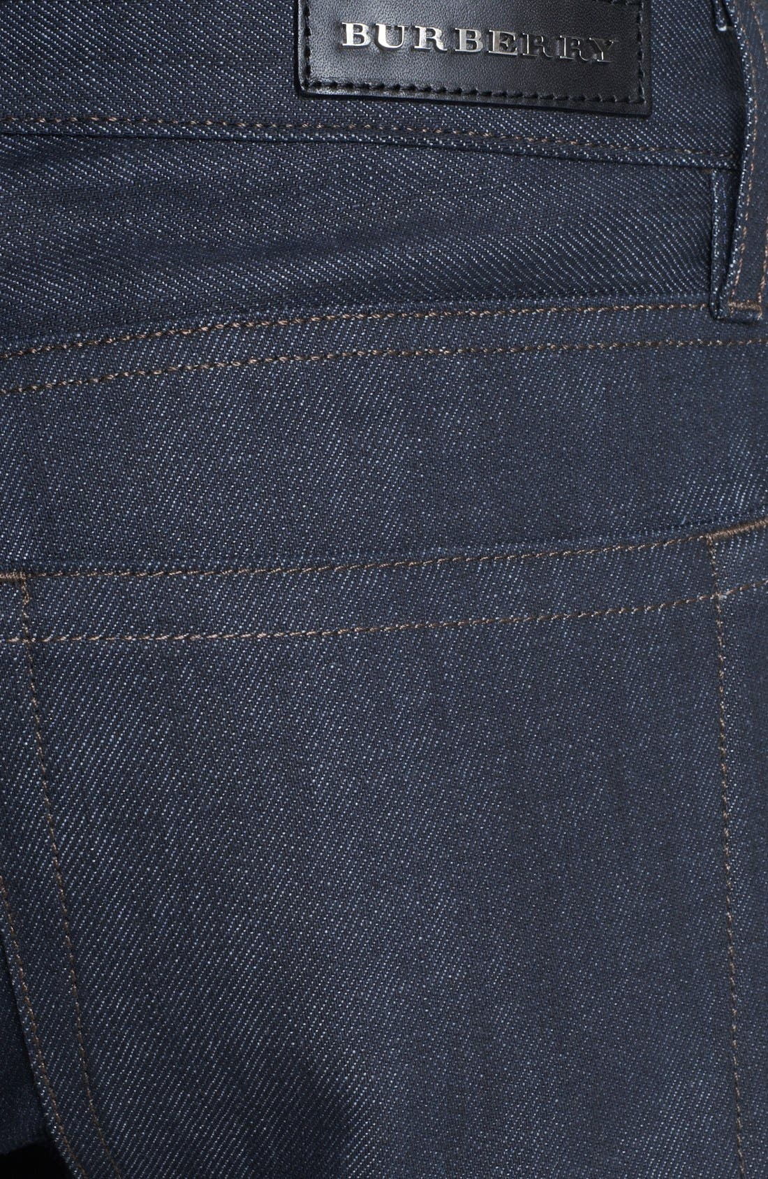 Alternate Image 4  - Burberry London Coated Slim Fit Jeans (Navy)