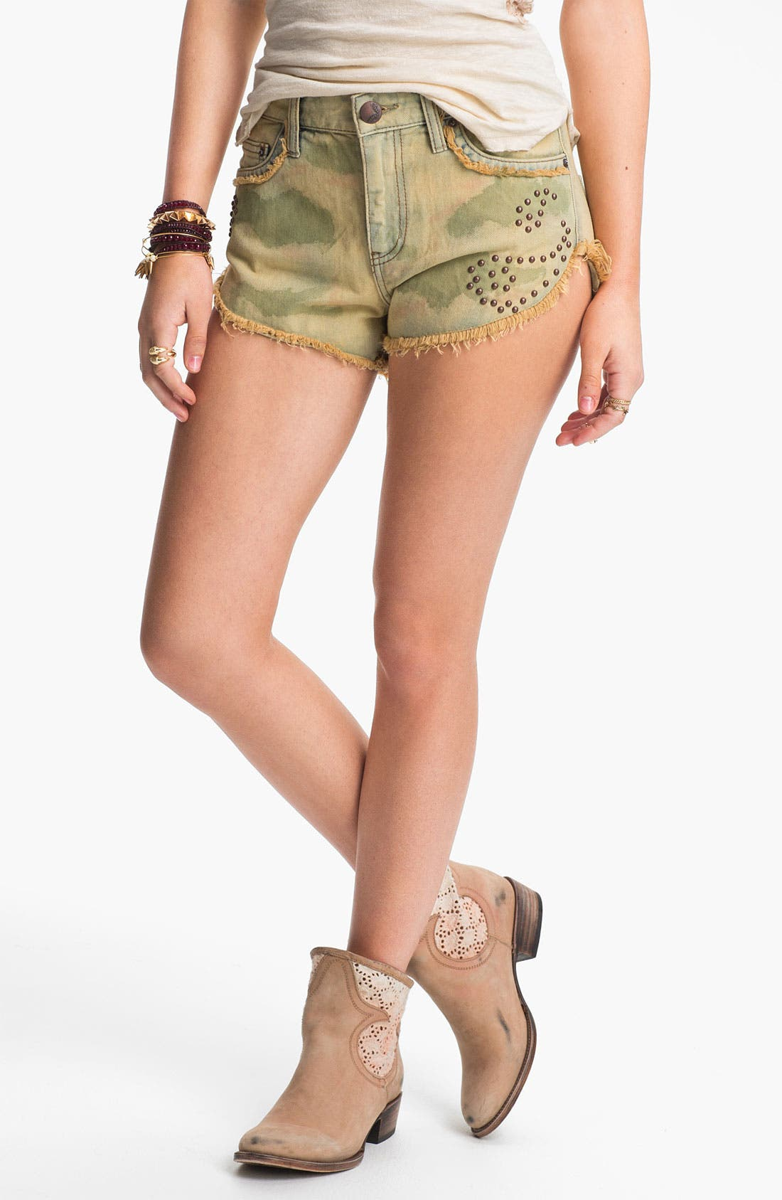 Alternate Image 1 Selected - Free People Studded Camo Cutoff Denim Shorts (Castro)