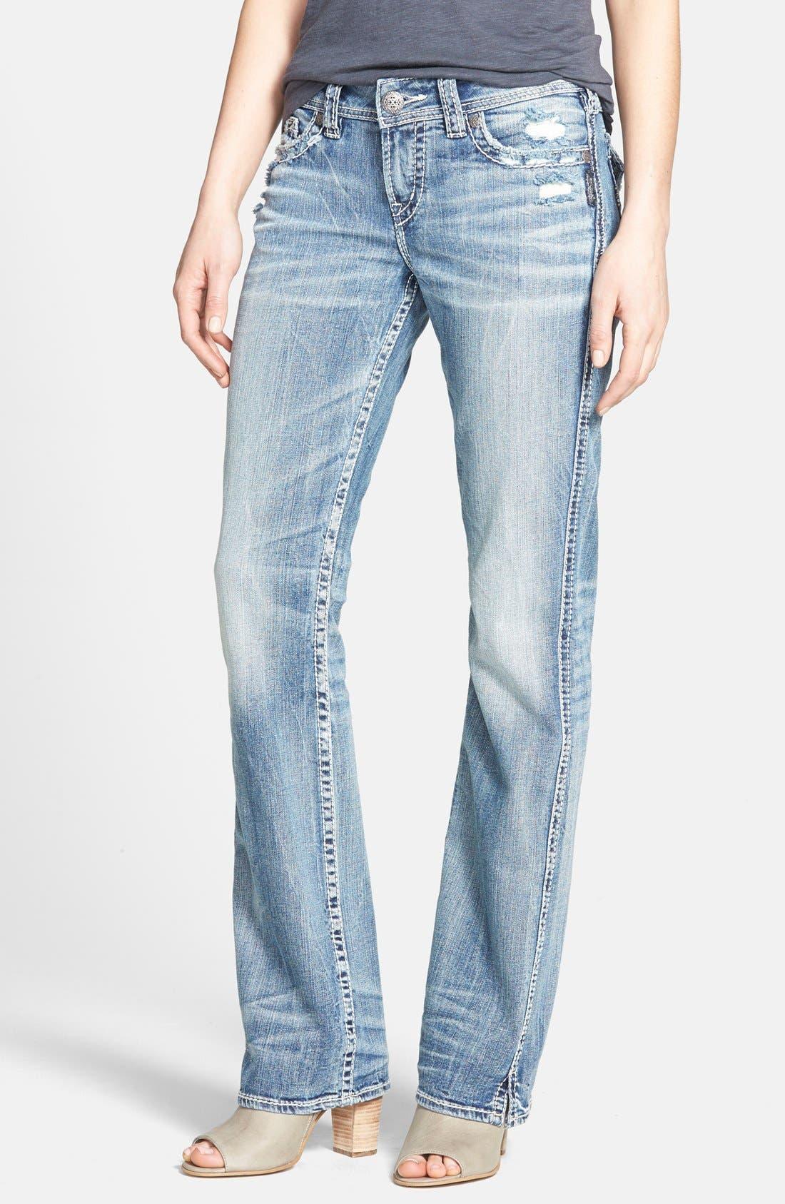 Alternate Image 1 Selected - Silver Jeans Co. 'Suki' Distressed Flap Pocket Slim Bootcut Jeans (Indigo)