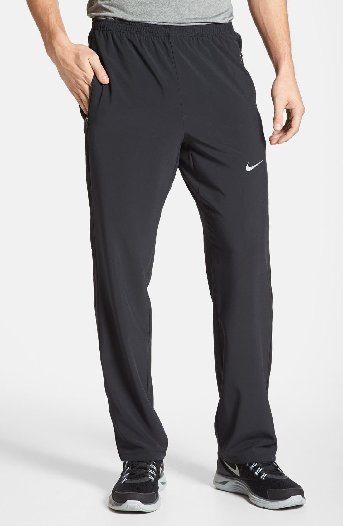 Alternate Image 1 Selected - Nike 'Dri-FIT SW' Stretch Woven Pants