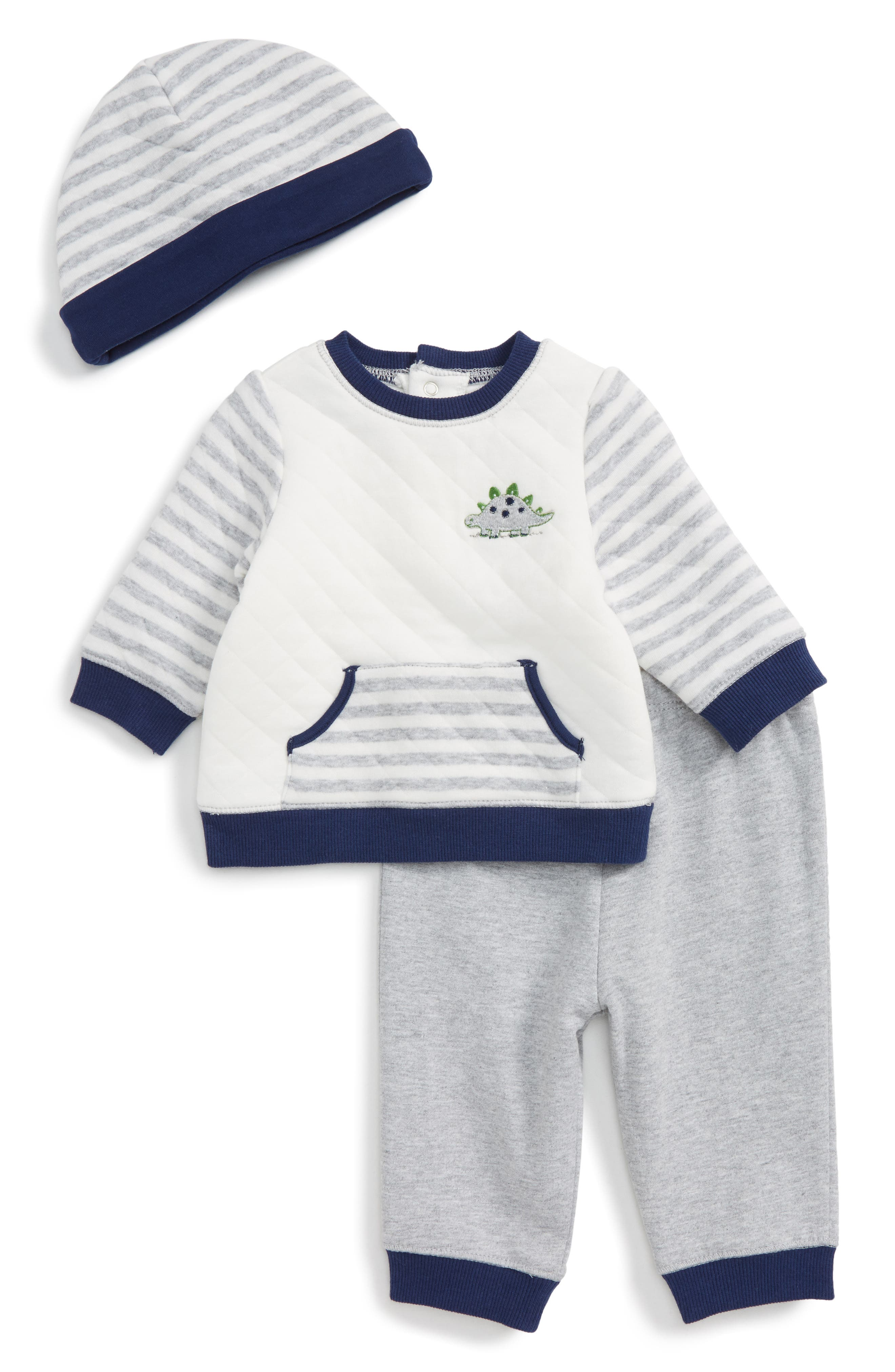 Nordstrom baby boy grey tee shirt and blue and white ikat shorts set. Shorts have a grey fabric waistband that matches the Tee. This is % cotton and the tee and waistband are very soft against baby.