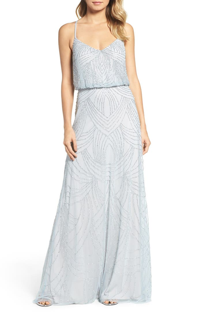 Typically long and fitted, beaded dresses are encrusted with beads or sequins. Some are embellished from head to toe while others focus the beading on mostly the bodice or a stunning belt. Besides the typical long fitted version of a beaded dress, there are also many short or two piece styles. A common look for the back of this dress is an open.