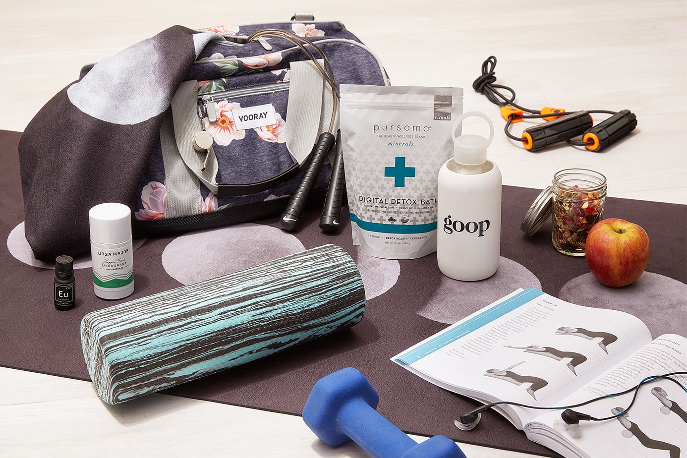 goop fitness products on a yoga mat.
