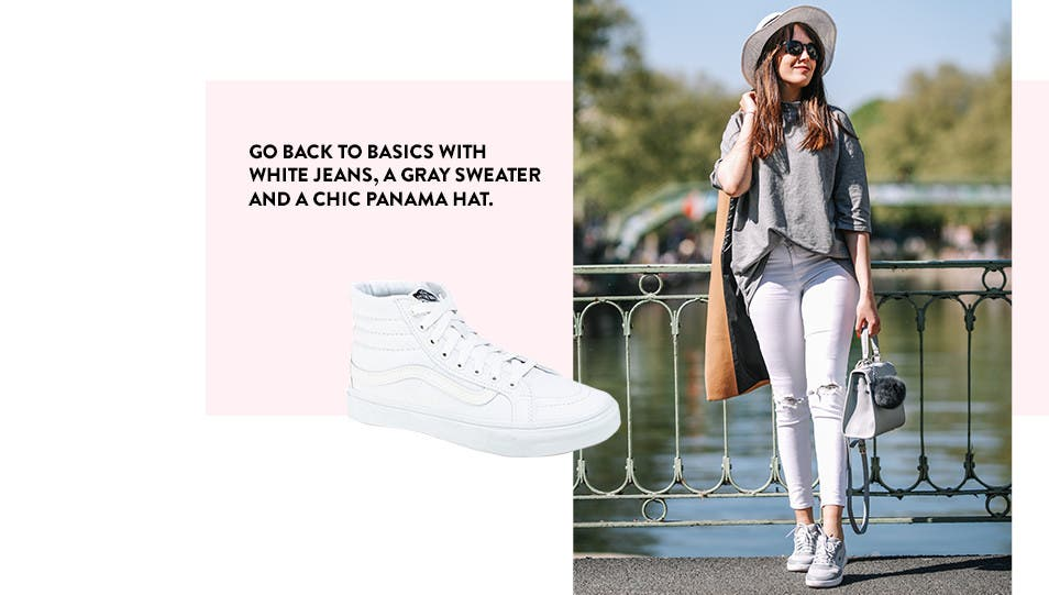 Go back to basics with white jeans, a gray sweater and a chic Panama hat.