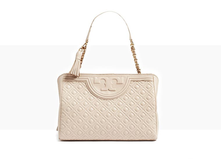 Tory Burch handbags and wallets.