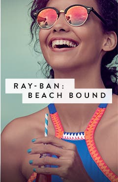 Beach bound in Ray-Ban women's sunglasses.