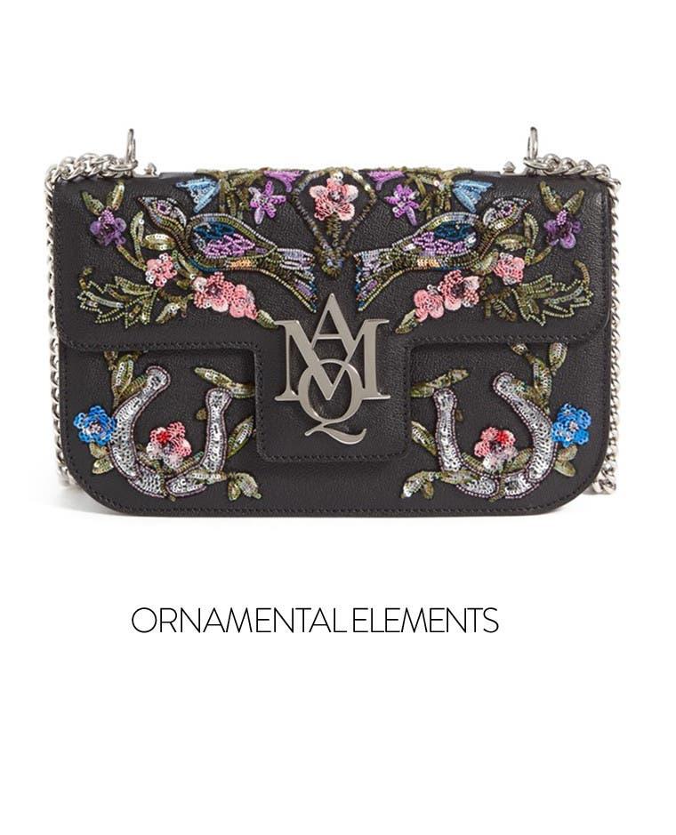 Ornamental elements: embellished handbags.