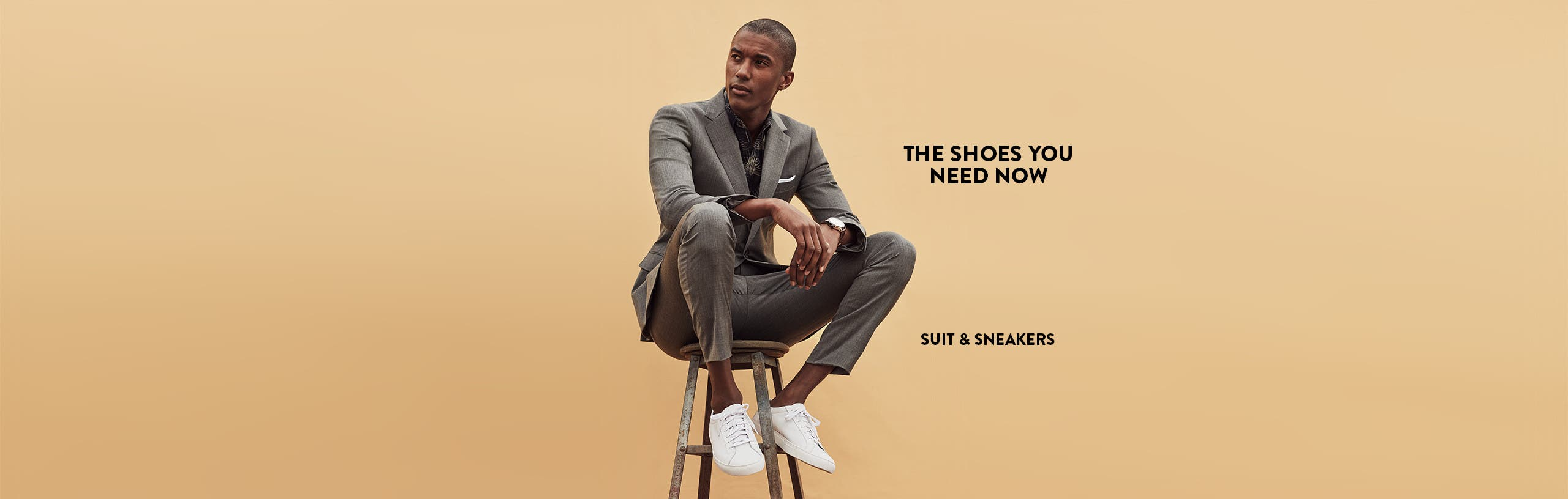 The shoes you need now: sneakers with a suit.
