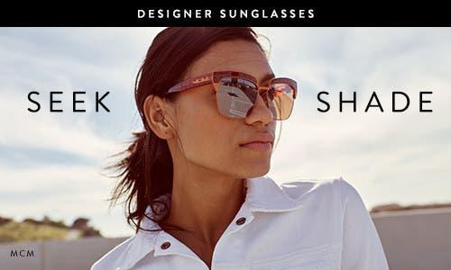 Seek shade with MCM sunglasses.