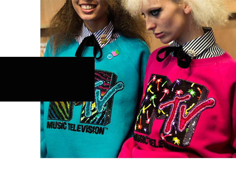 Manic pinks, crimped hair and zebra stripes clashed purposefully against army coats, dotted lace and glittery throwback logos.