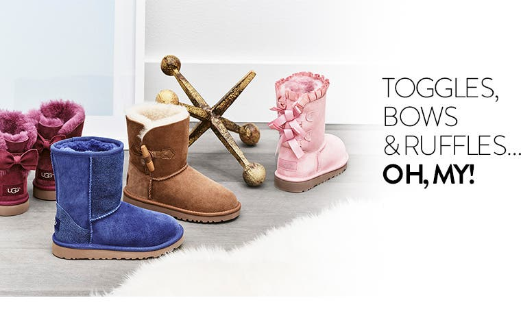 Toggles, bows and ruffles. UGG boots for kids.