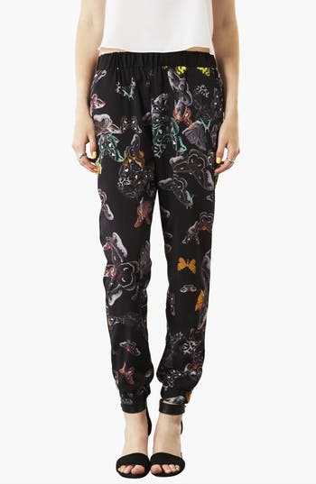 Main Image - Topshop 'Clutter Moth' Print Tapered Pants