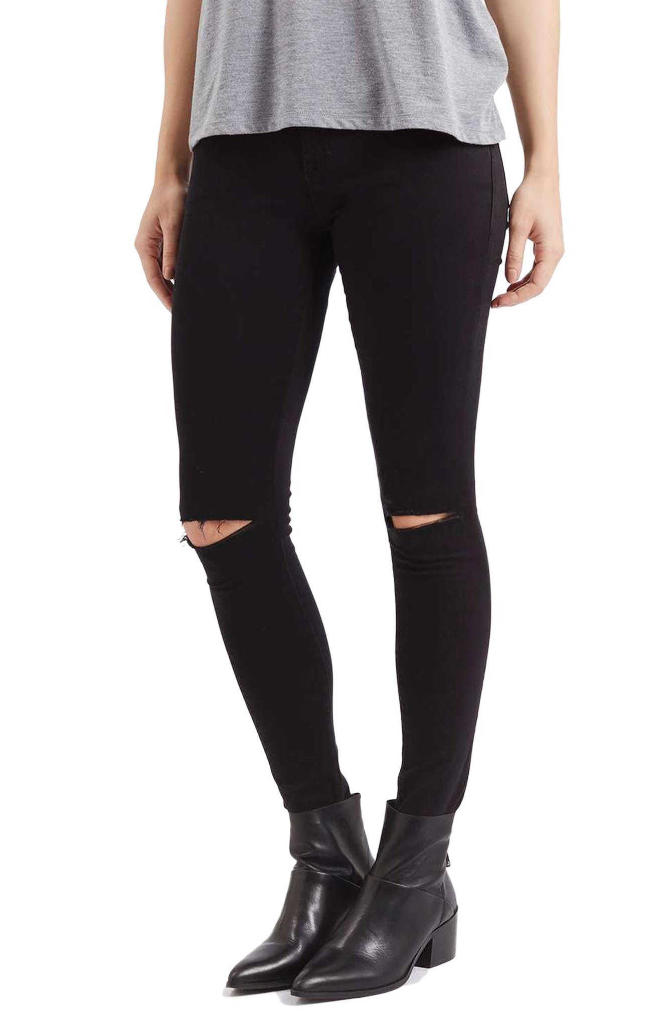 Black torn up skinny jeans