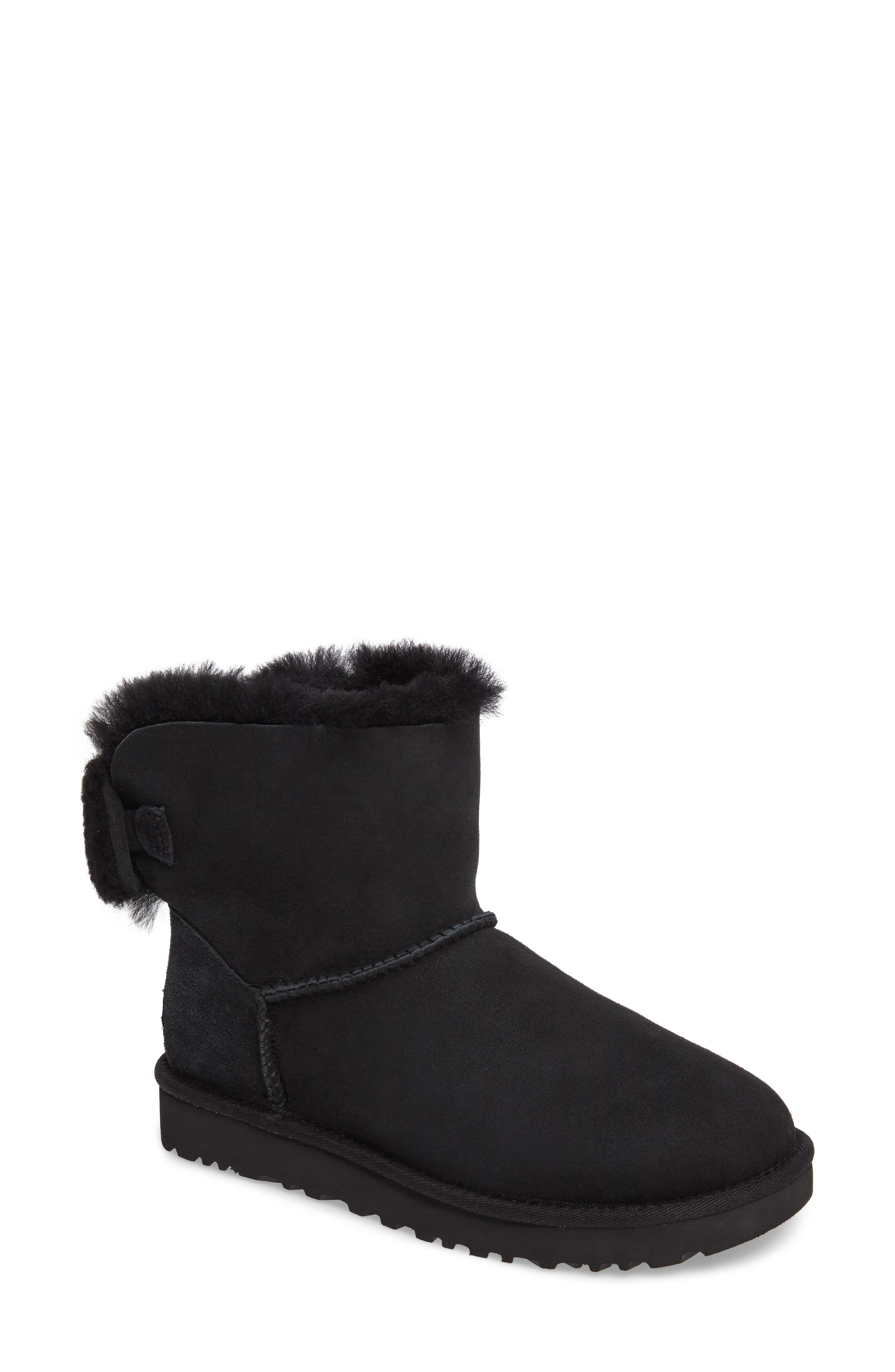 Arielle Genuine Shearling Bootie,                             Main thumbnail 1, color,                             Black Suede