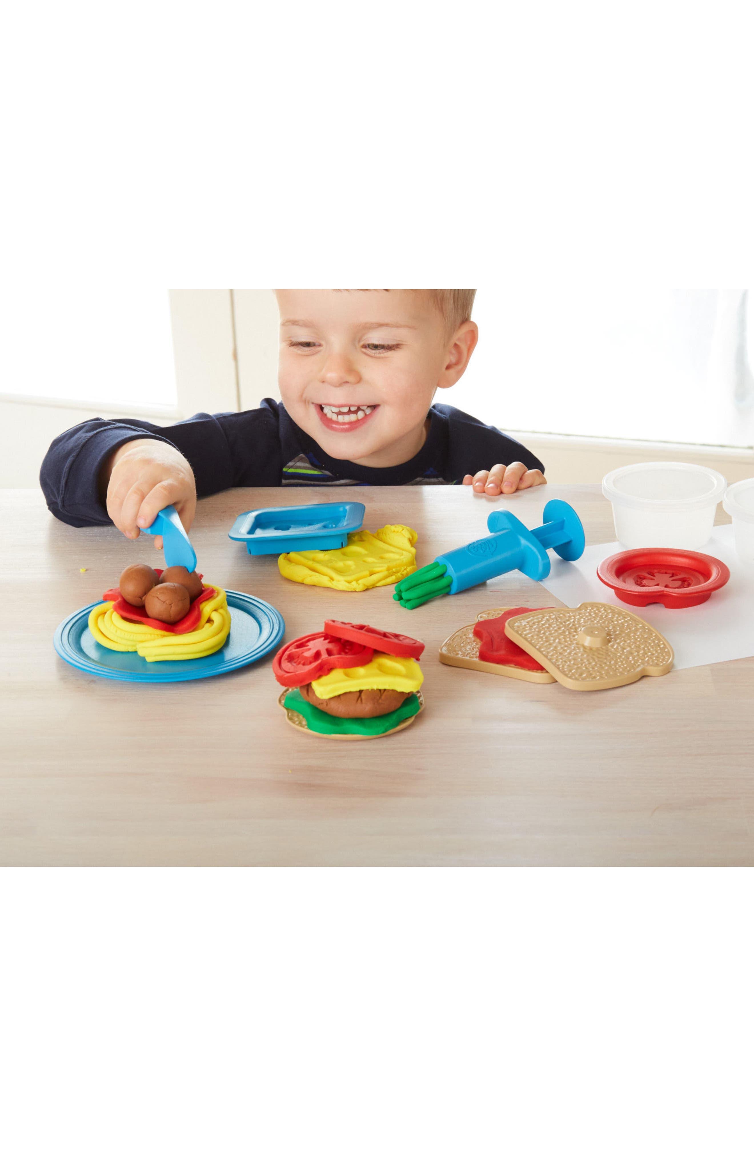 Alternate Image 3  - Green Toys 18-Piece Plastic Meal Maker Dough Set