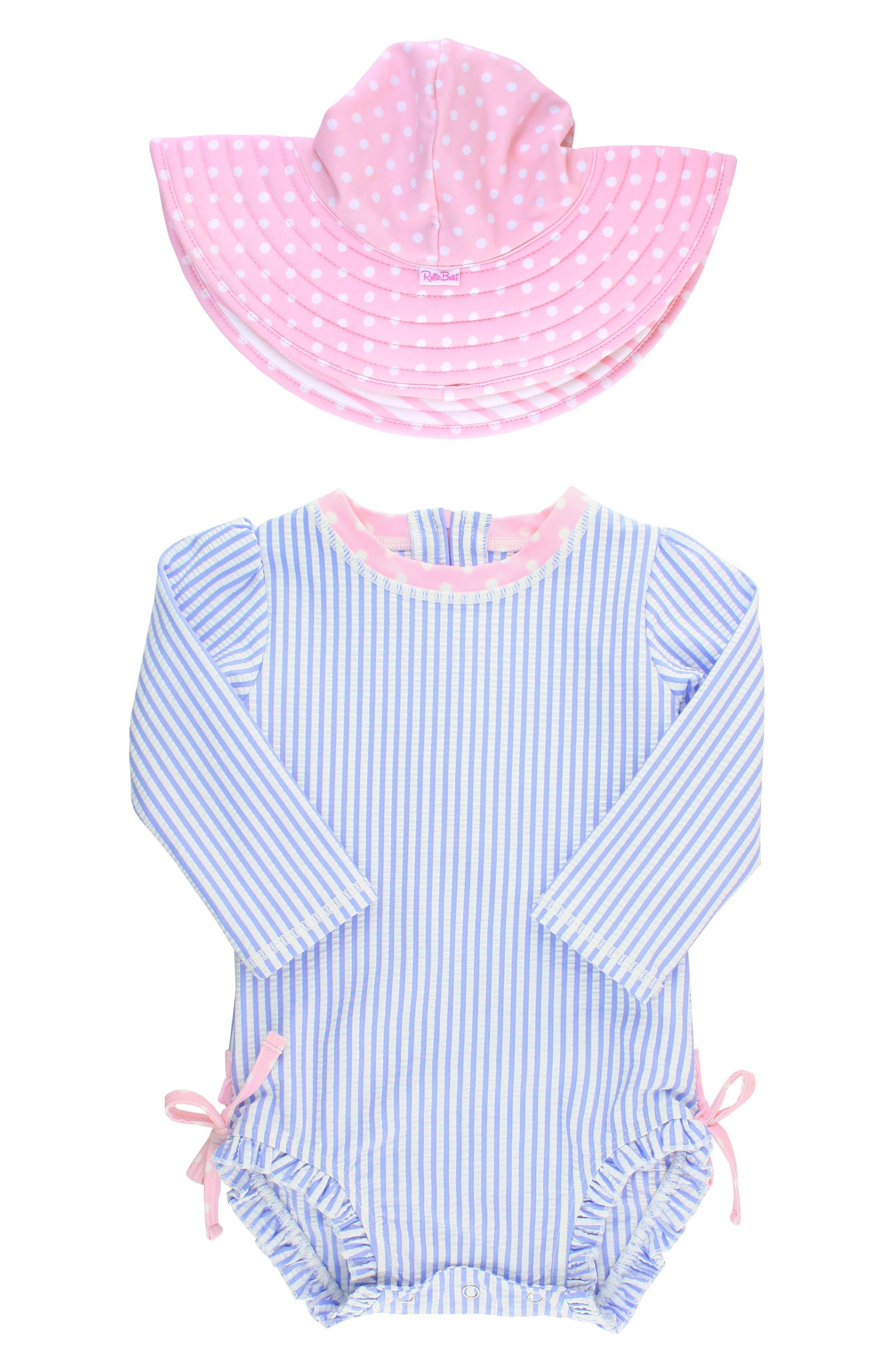 Main Image - Ruffle Butts Seersucker One-Piece Rashguard Swimsuit & Hat Set (Baby Girls)