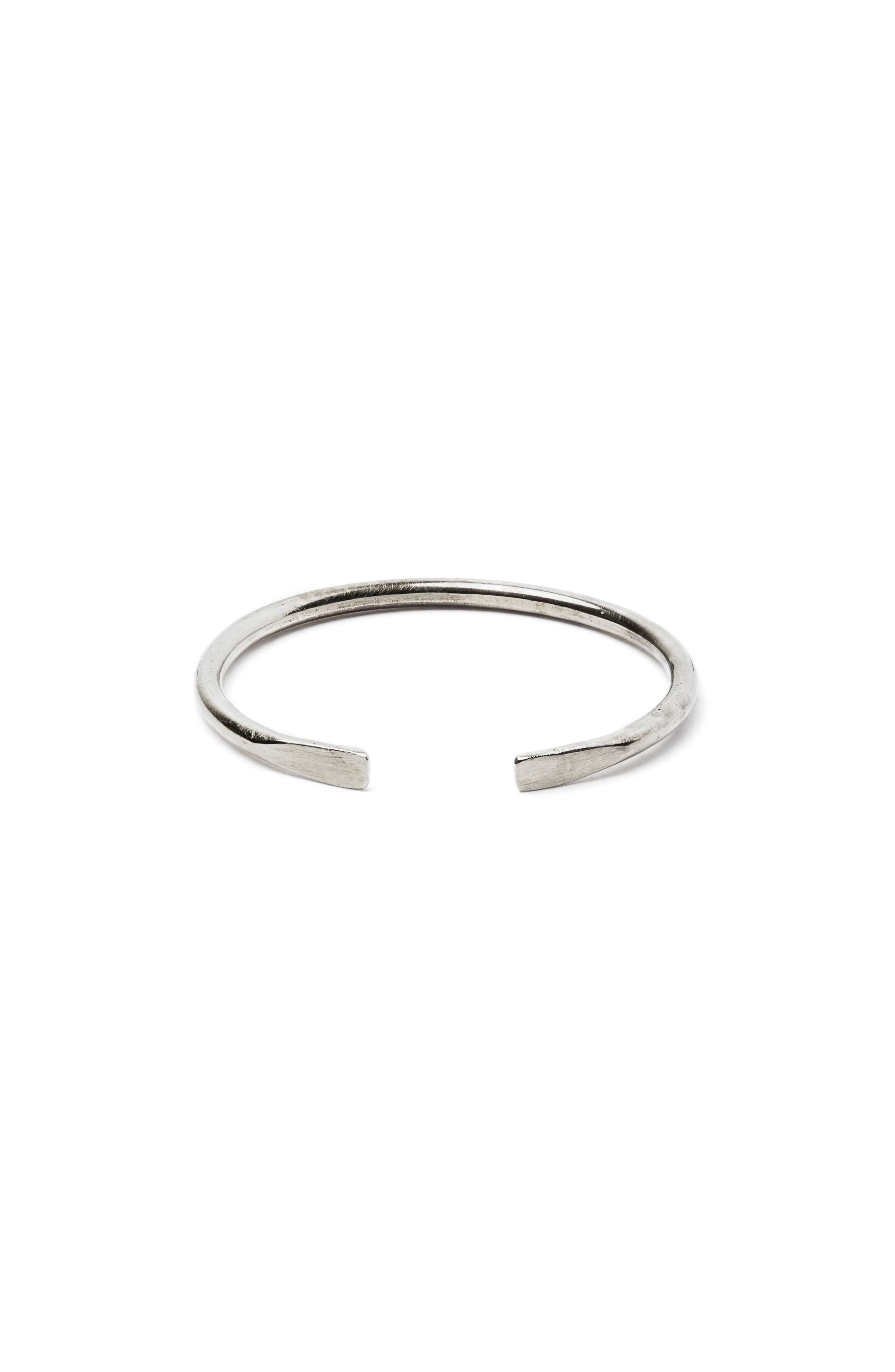 TITLE OF WORK 18K White Gold Ring in Silver