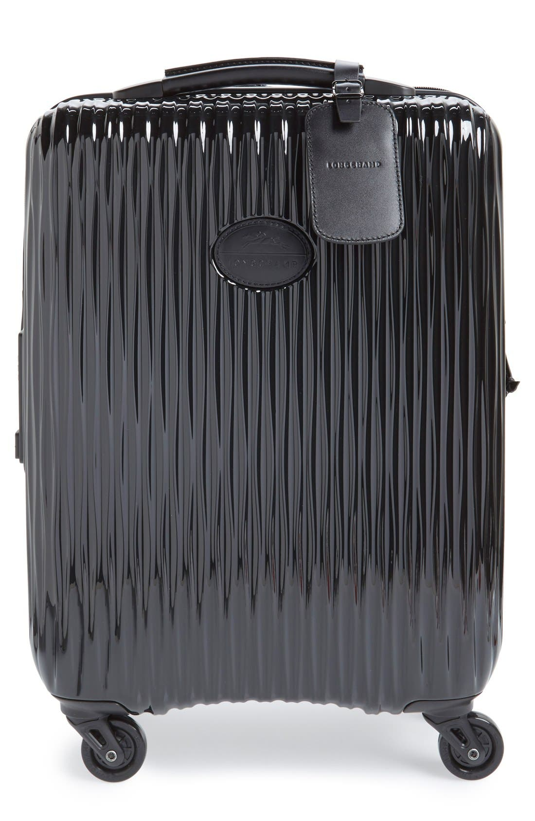 'Fairval' Four-Wheeled Hard Shell Suitcase,                             Main thumbnail 1, color,                             Black