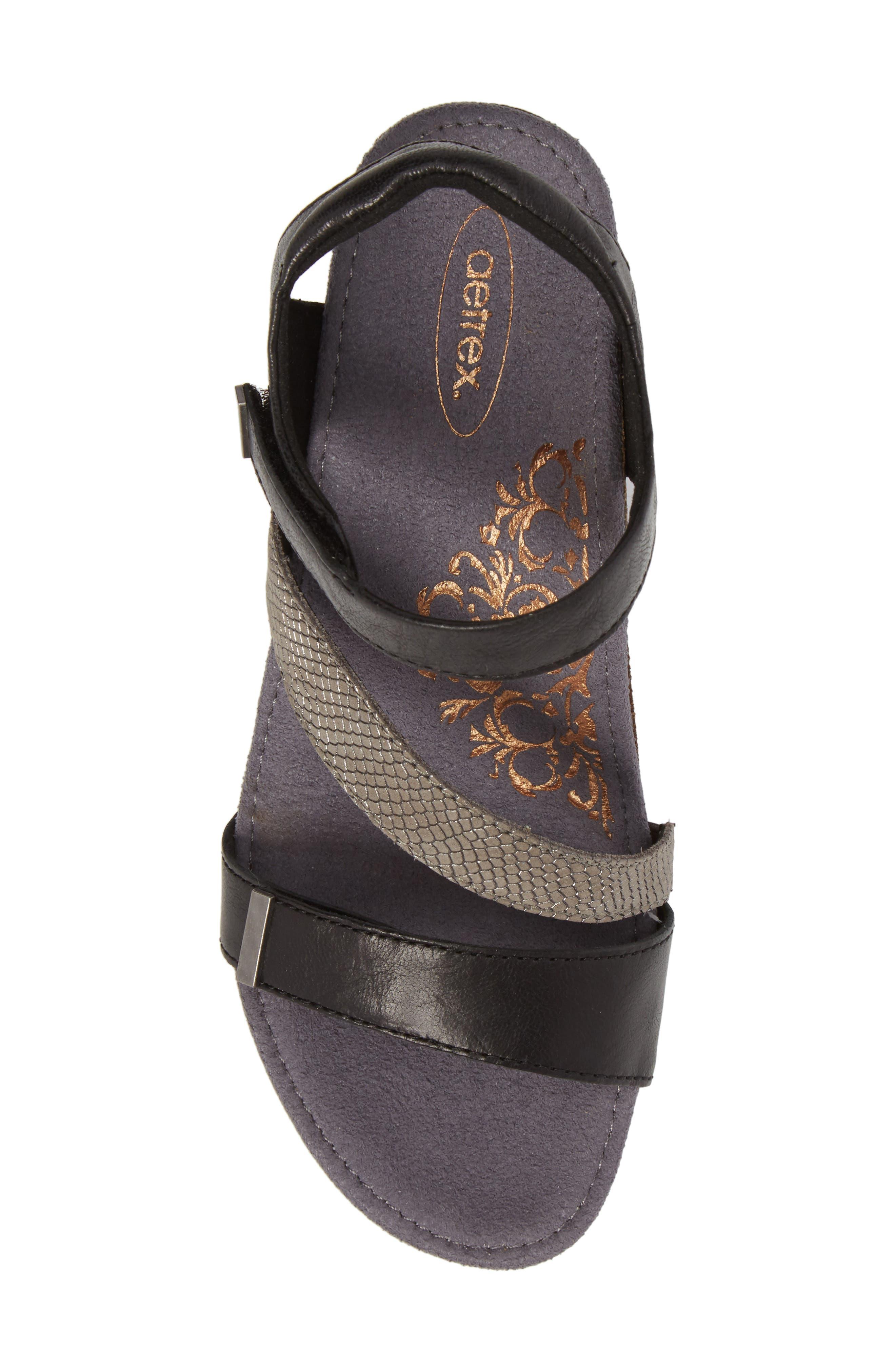 Brynn Asymmetrical Wedge Sandal,                             Alternate thumbnail 5, color,                             Black Leather