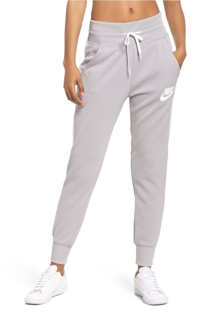 These jogger pants are fitted at the waist and ankle and can easily be dressed up with a solid T, an open sweater and your favorite scarf. Play it straight with a pair in denim, chambray or a solid olive or maroon.