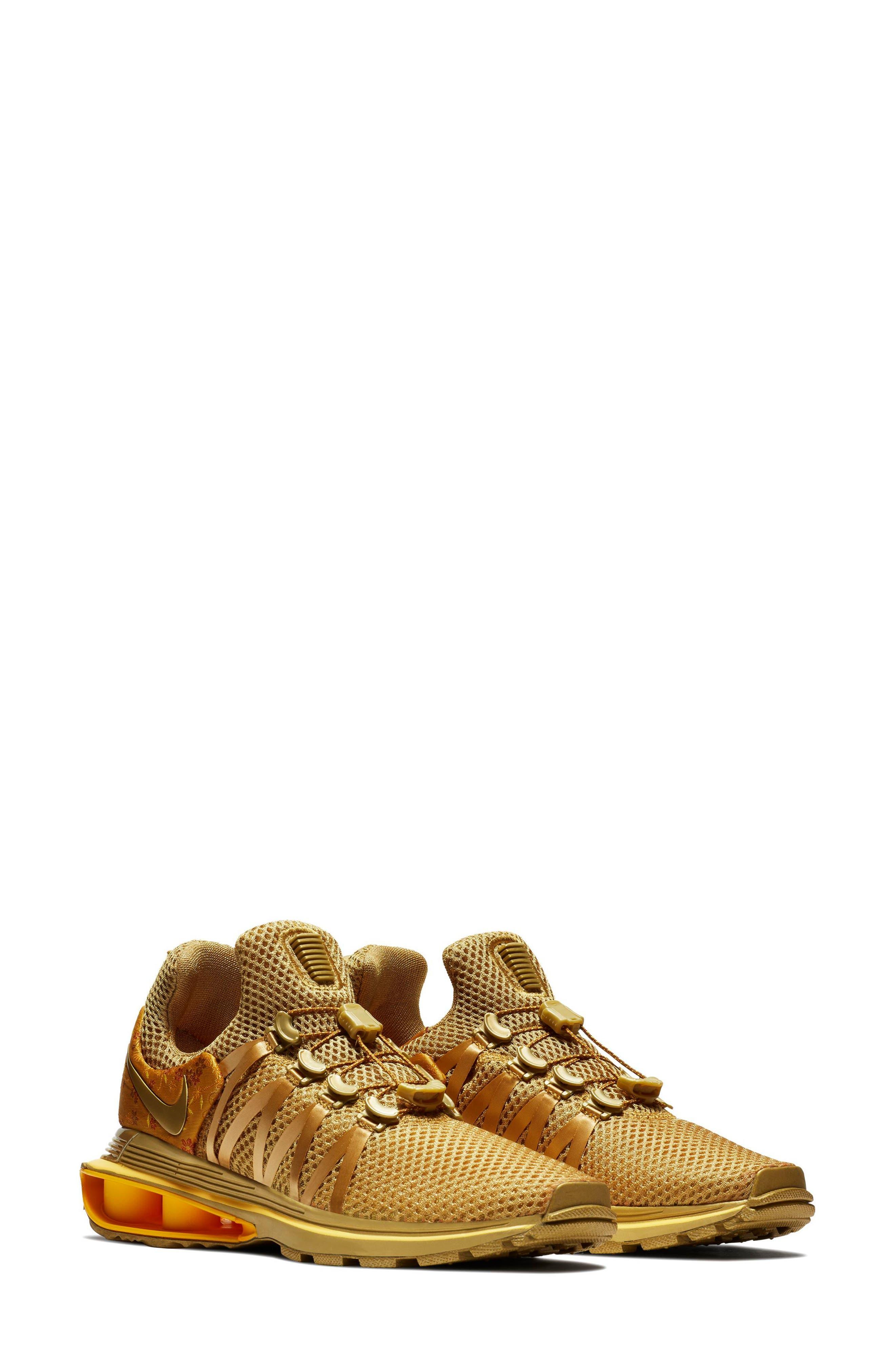 Shox Gravity Sneaker,                             Main thumbnail 1, color,                             Metallic Gold/ Metallic Gold