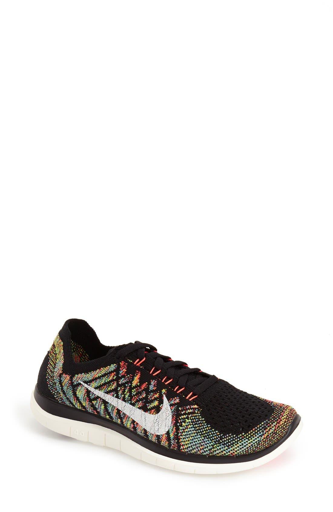 'Free 4.0 Flyknit' Running Shoe,                         Main,                         color, Black/ Orange/ Blue
