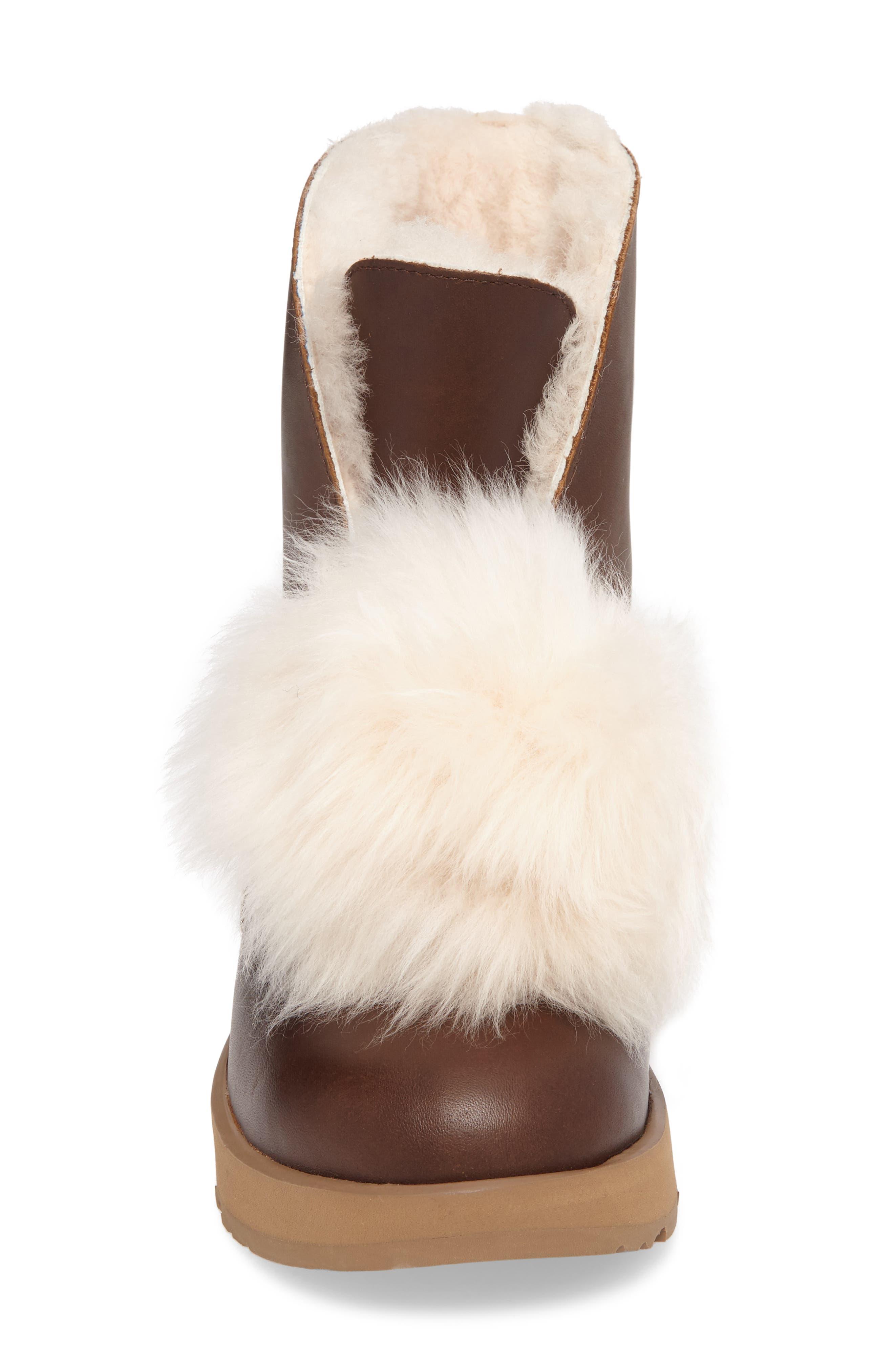 Alternate Image 4  - UGG® Isley Genuine Shearling Pompom Waterproof Boot (Women)