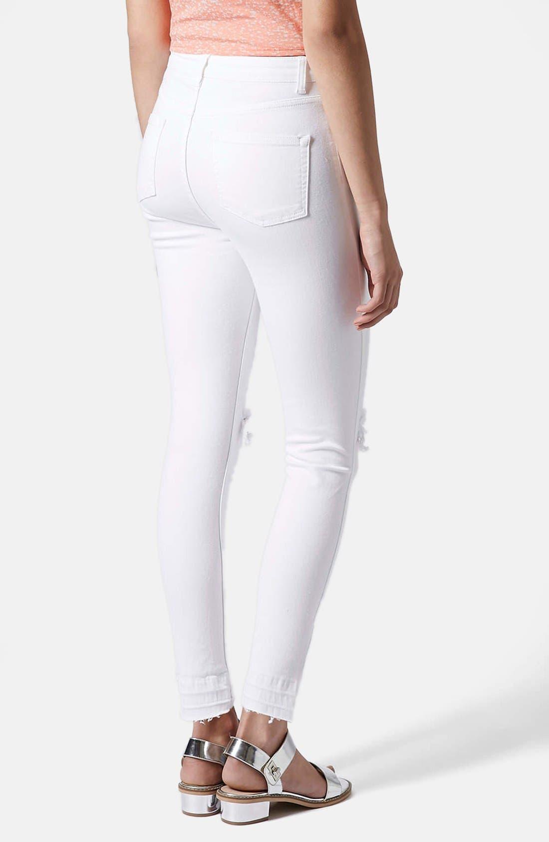 Alternate Image 2  - Topshop Moto 'Jamie' Ripped High Rise Ankle Skinny Jeans (White) (Regular & Short)
