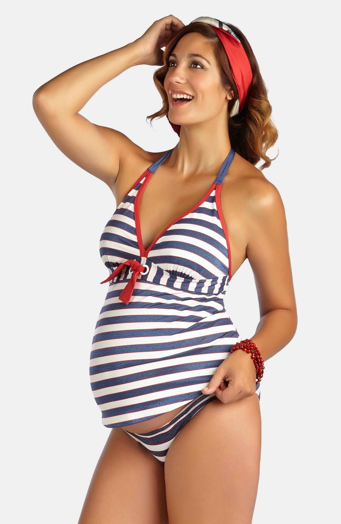 Pfft, that never happens when you're pregnant. At least that's what you'd think if you're trying to find one online. There are two sites I found: Bravissimo and Linda's that carry suits for us girls with the guns, and bikinis and tankinis look to be your best best.