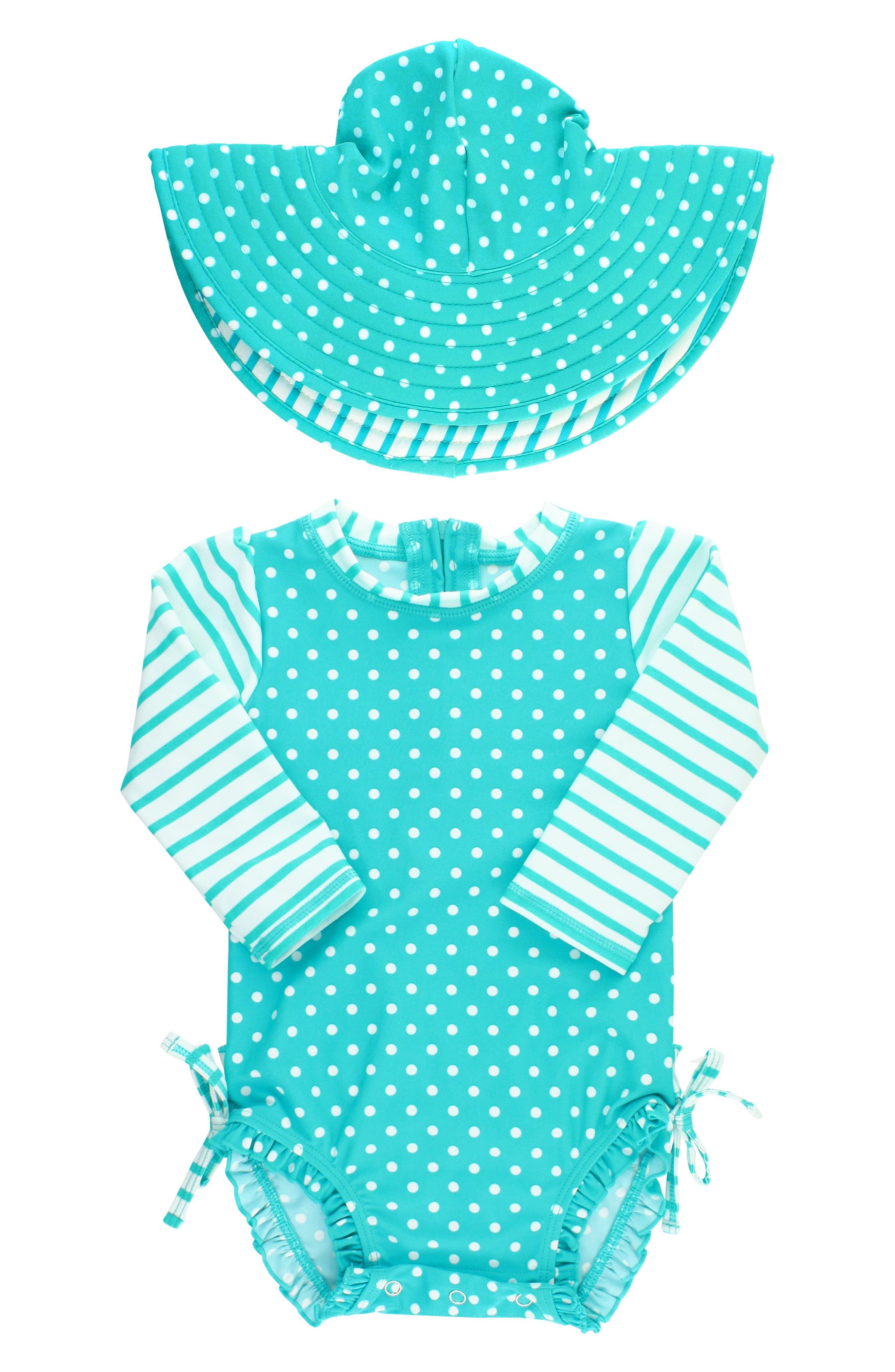 Alternate Image 1 Selected - RuffleButts One-Piece Rashguard Swimsuit & Hat Set (Baby Girls)
