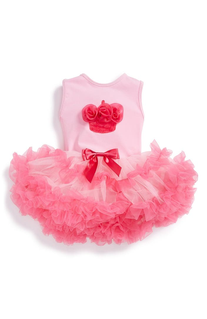 Baby Tutus. Feminine looks, gorgeous frills and super feminine colors create the Pink Taffy Designs Tutus line for girls. The materials that create these beautiful tutus are of the highest quality and the selection of these wonderful items is vast, along with different sizes and colors to choose from.