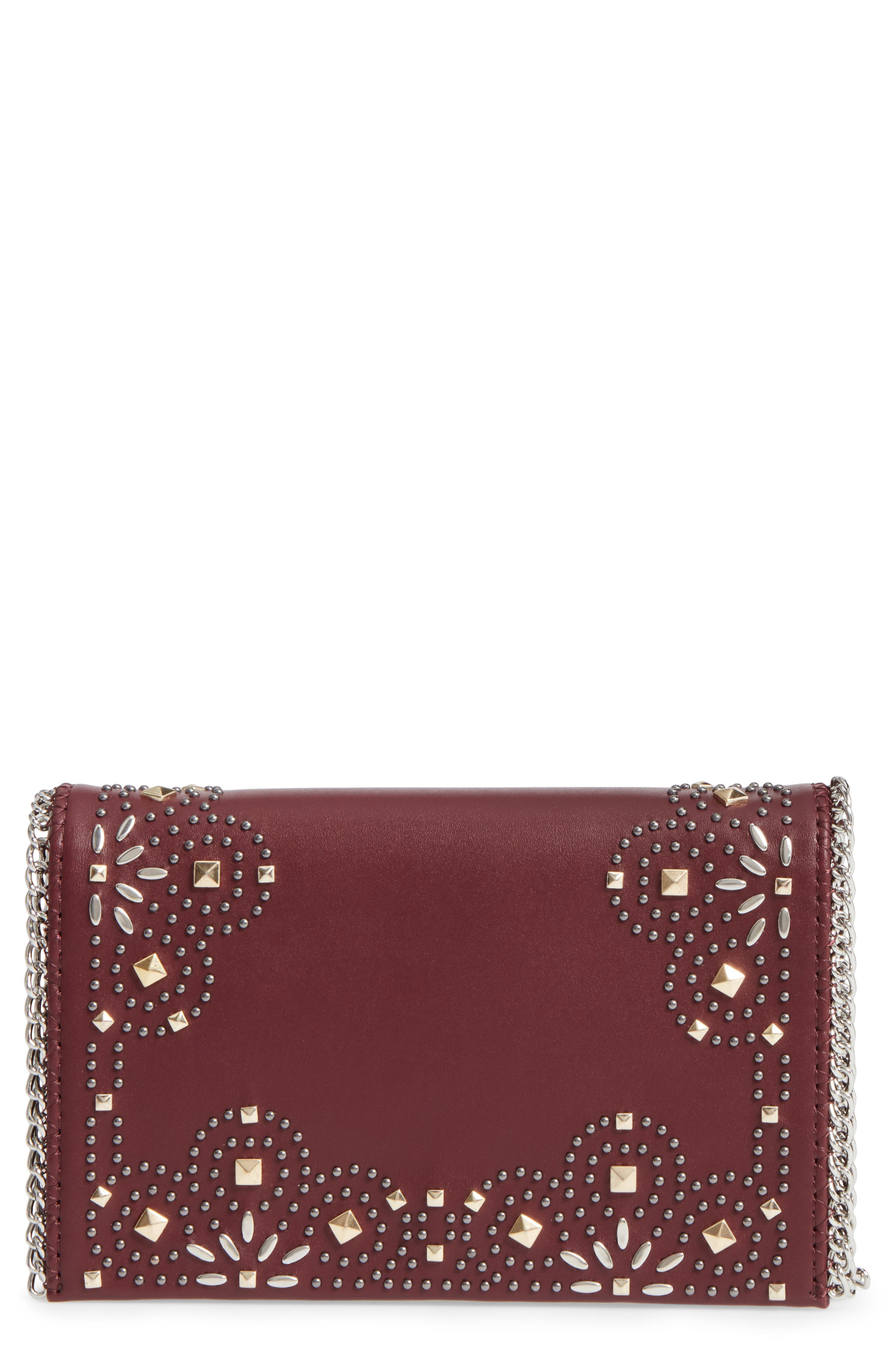Alternate Image 1 Selected - Chelsea28 Fleur Studded Faux Leather Convertible Clutch