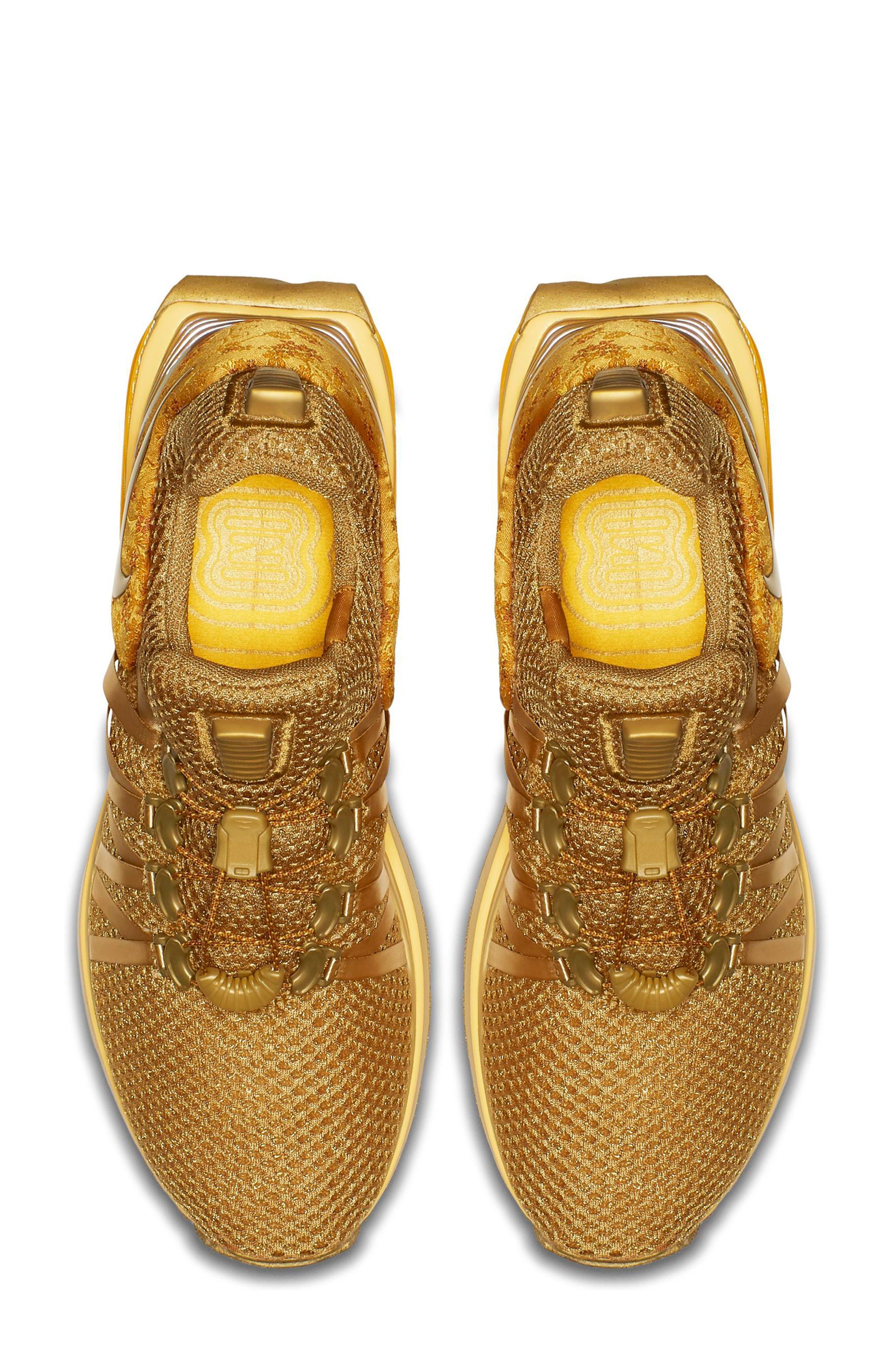 Shox Gravity Sneaker,                             Alternate thumbnail 4, color,                             Metallic Gold/ Metallic Gold