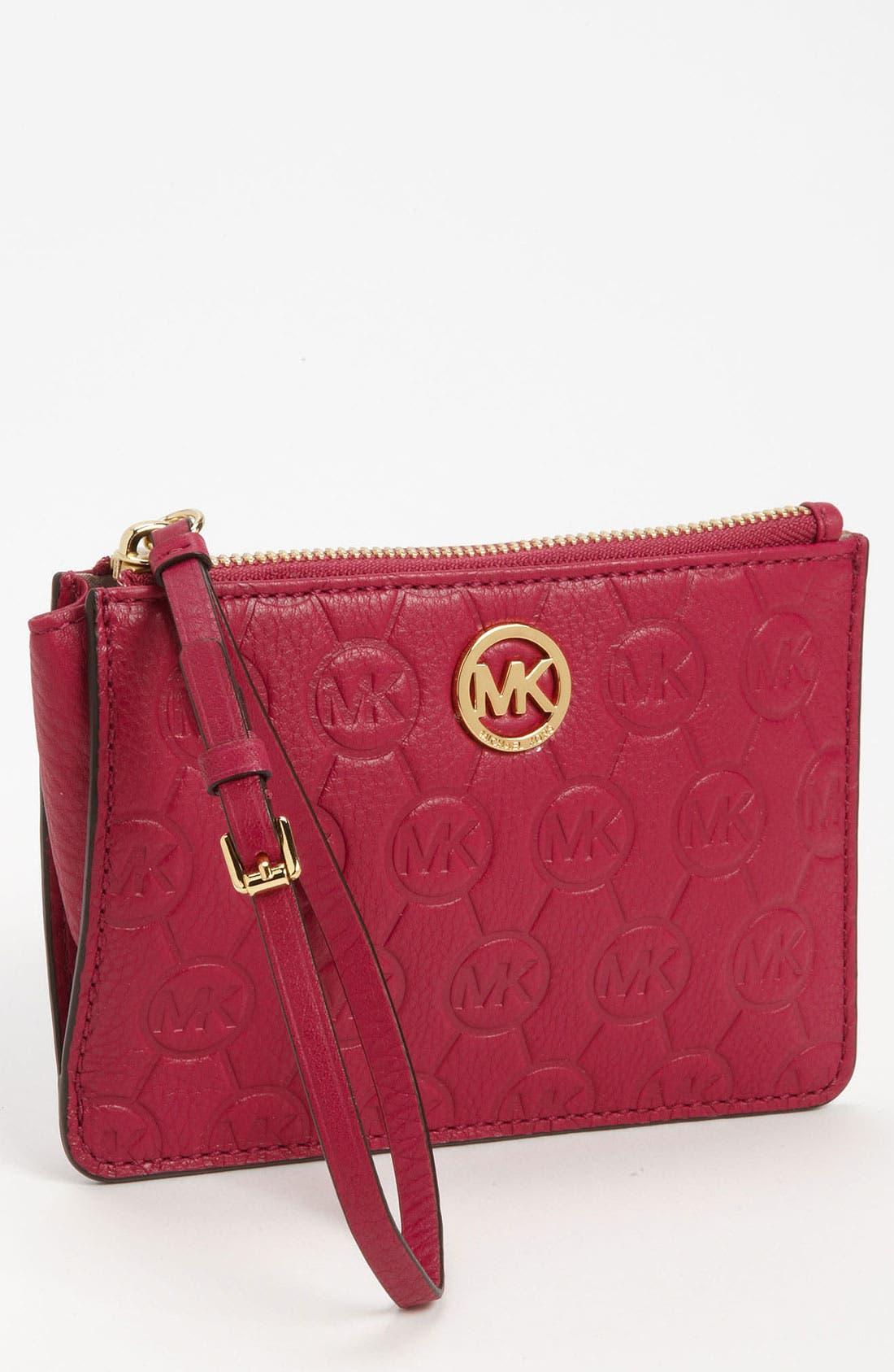 Alternate Image 1 Selected - MICHAEL Michael Kors Monogram Embossed Leather Wristlet