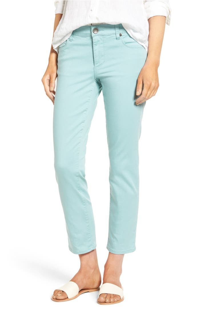 Bold hues of slim plaid ankle pants by Charter Club (only at Macy's) add the bright pop to your look. Pair them with a crisp cotton blouse and funky flats for a retro look. For instant glam, loose-fitting joggers from MICHAEL Michael Kors with strappy platform booties and a slinky white tee.