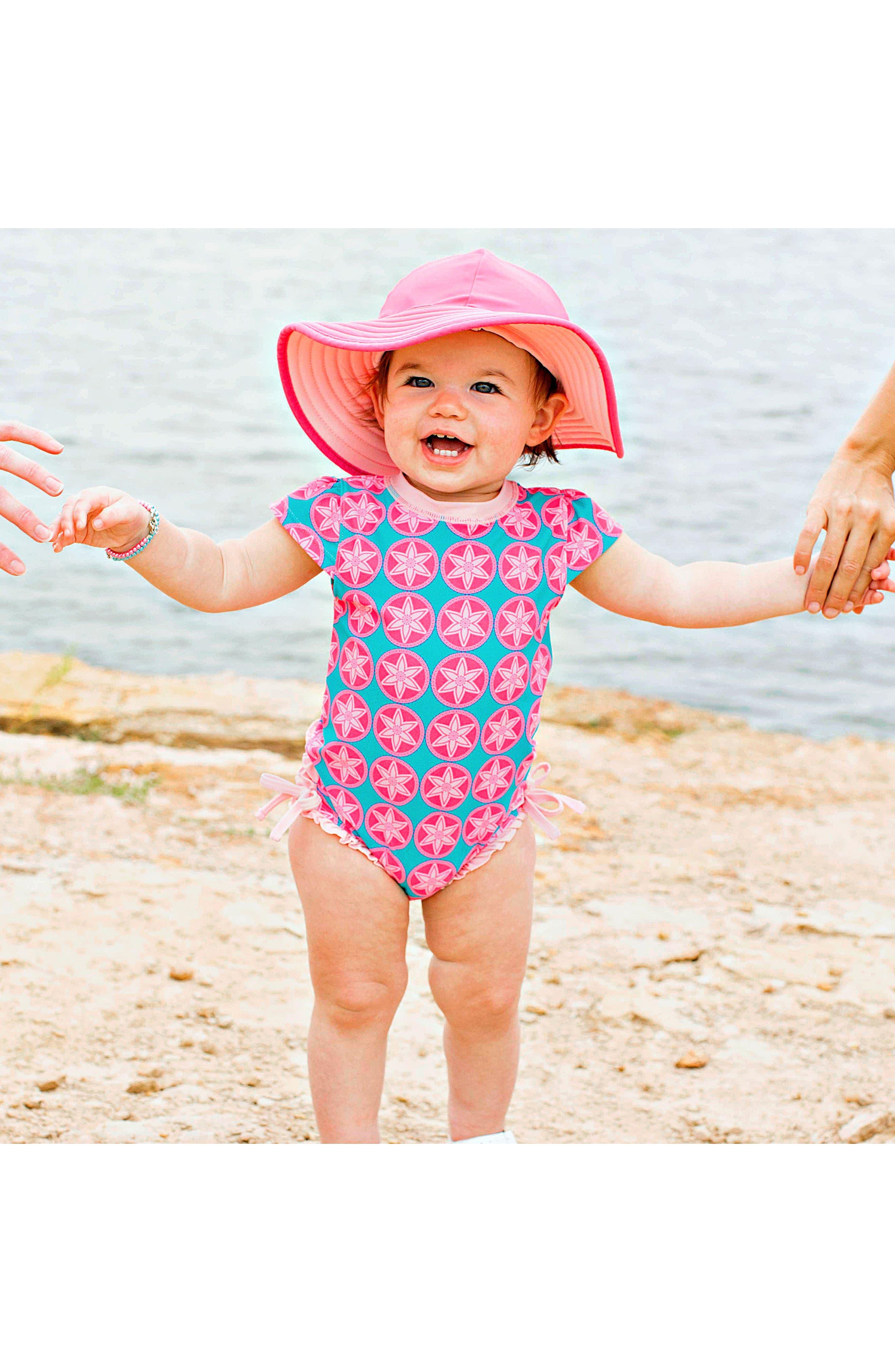 Alternate Image 3  - RuffleButts Salt Water Taffy One-Piece Swimsuit & Hat Set (Baby Girls)