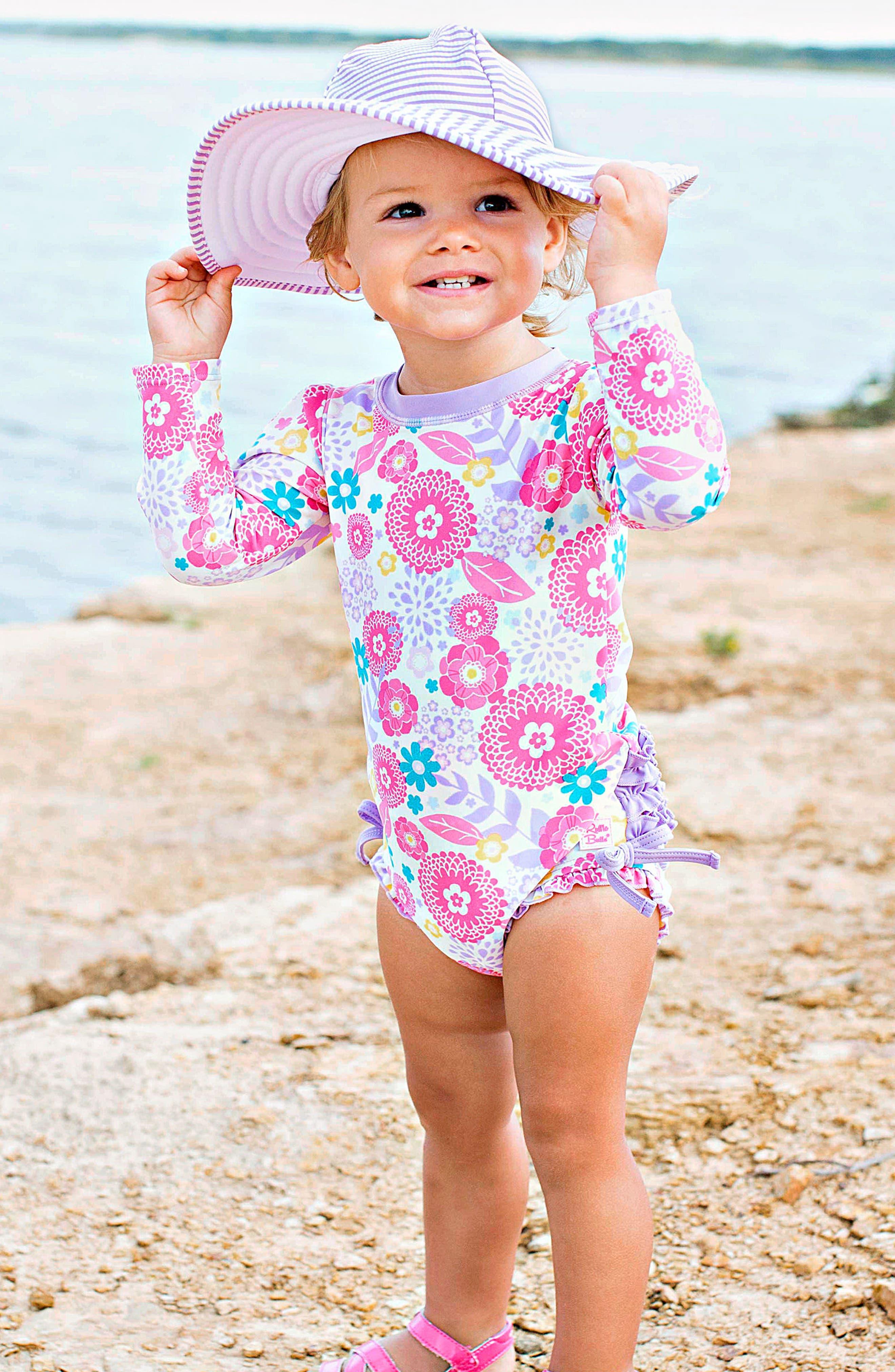 Alternate Image 2  - RuffleButts Blooming Buttercups One-Piece Rashguard Swimsuit & Hat Set (Baby Girls)
