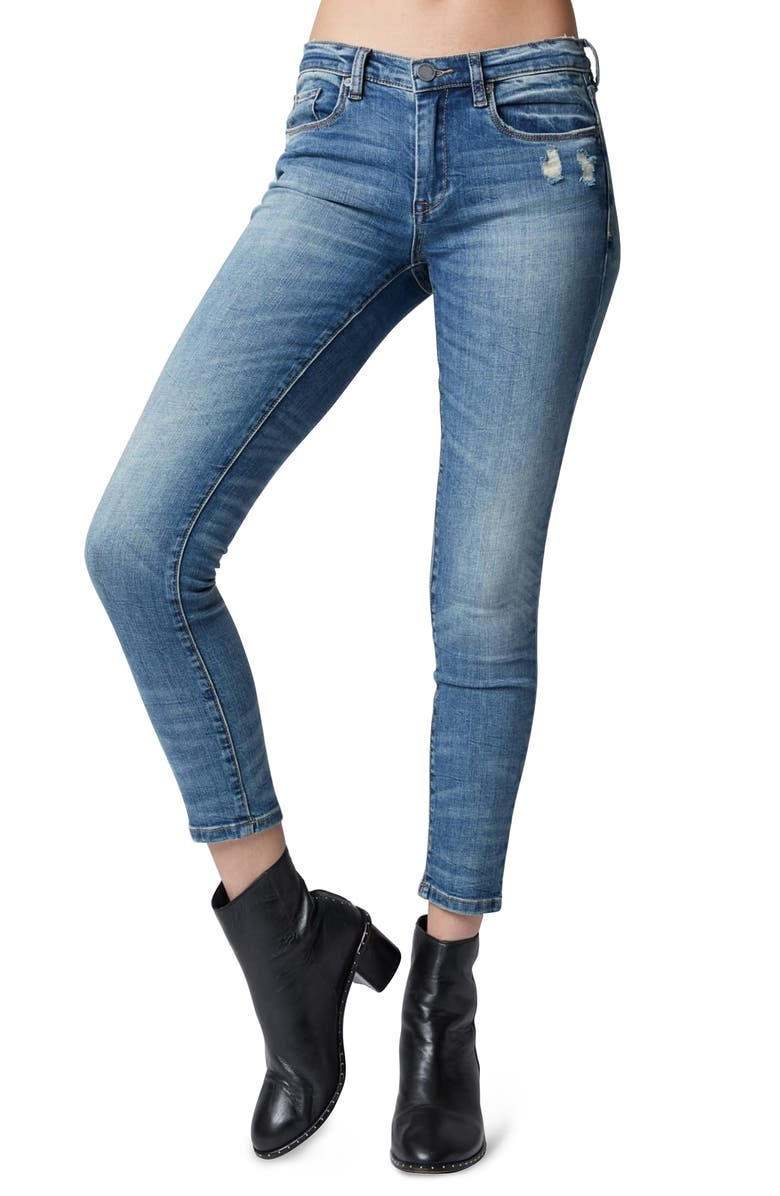 The Reade Distressed Skinny Jeans