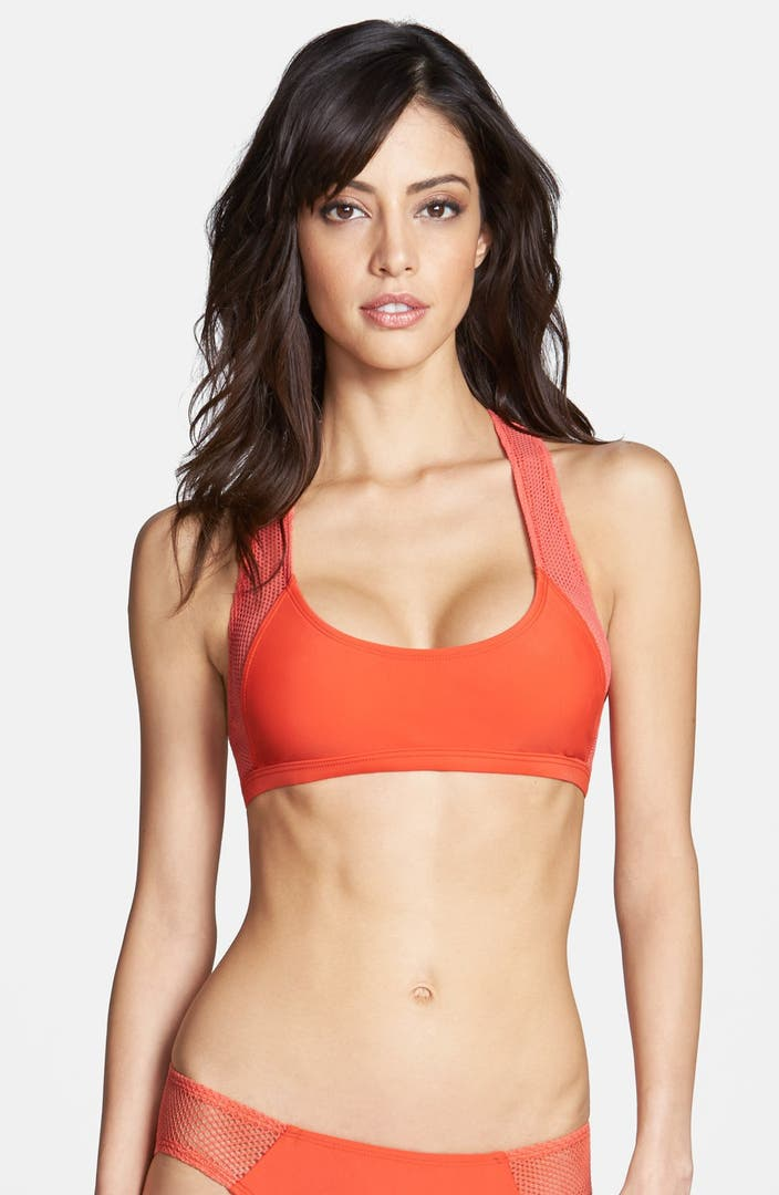 For a sporty look and active fit, try this high neck racer back bikini top from JAG. Adorned with a chevron print and removable cups for shaping -- this top is an essential piece of your swimwear drawer.