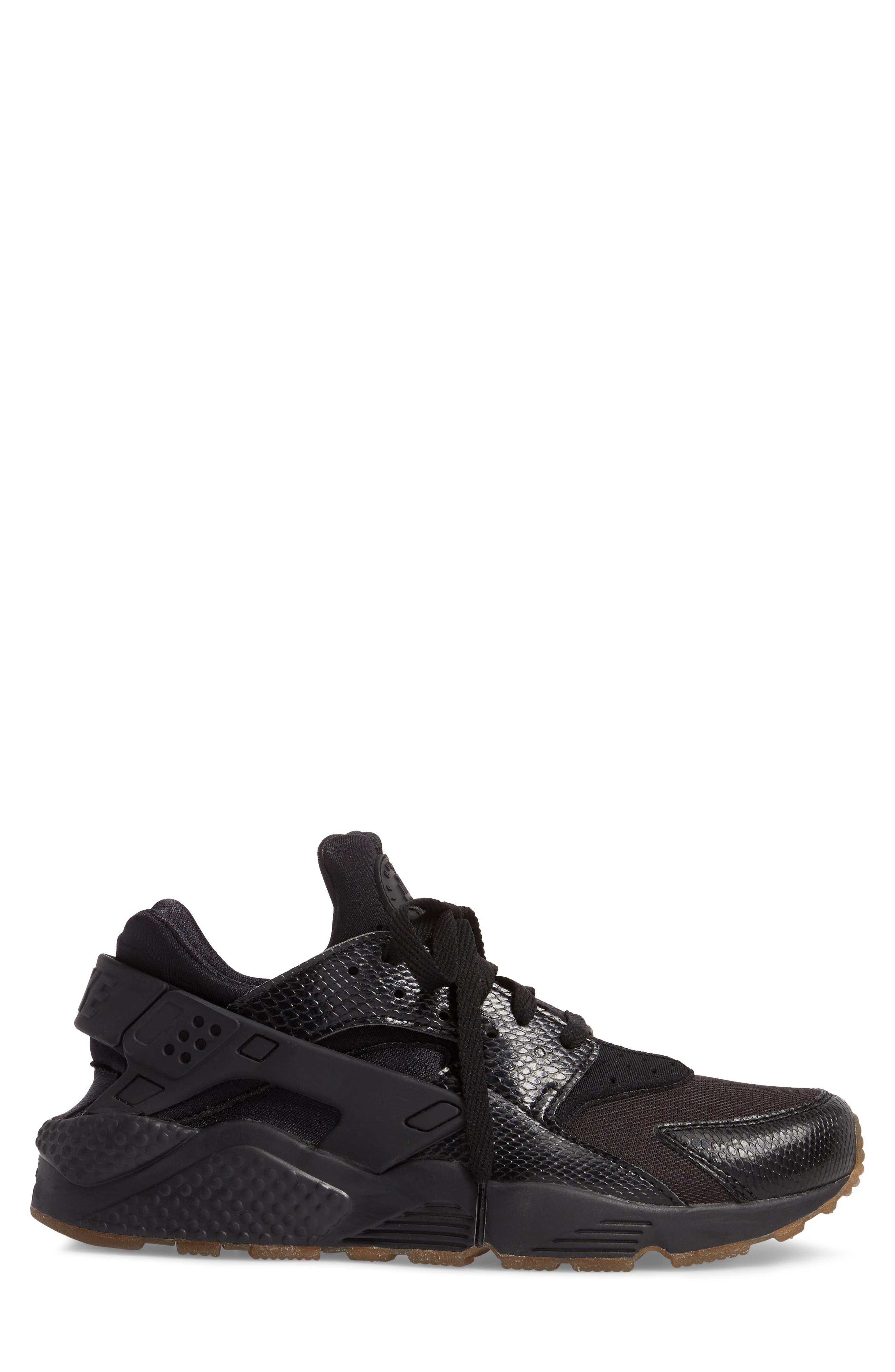 'Air Huarache' Sneaker,                             Alternate thumbnail 3, color,                             Black/ Elemental Gold/ Brown
