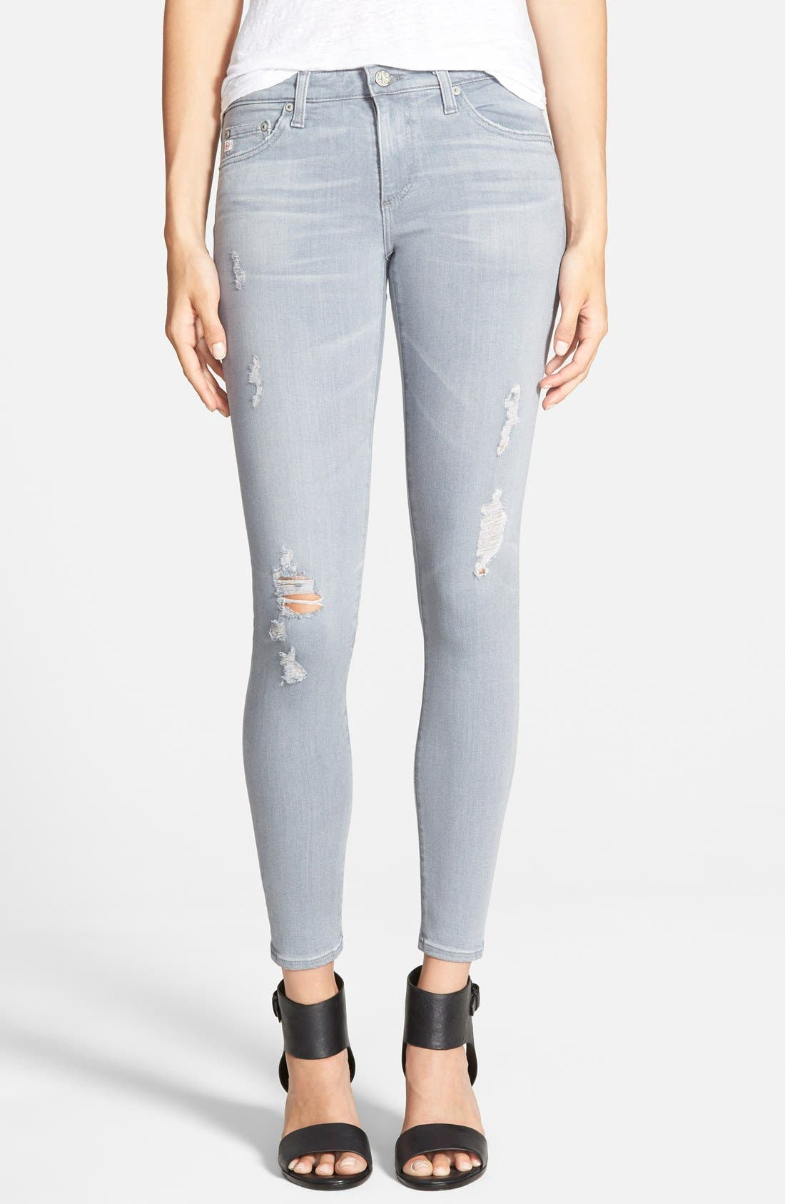 Alternate Image 1 Selected - AG Ankle Super Skinny Jeans (10 Years Light Onyx Destroyed)